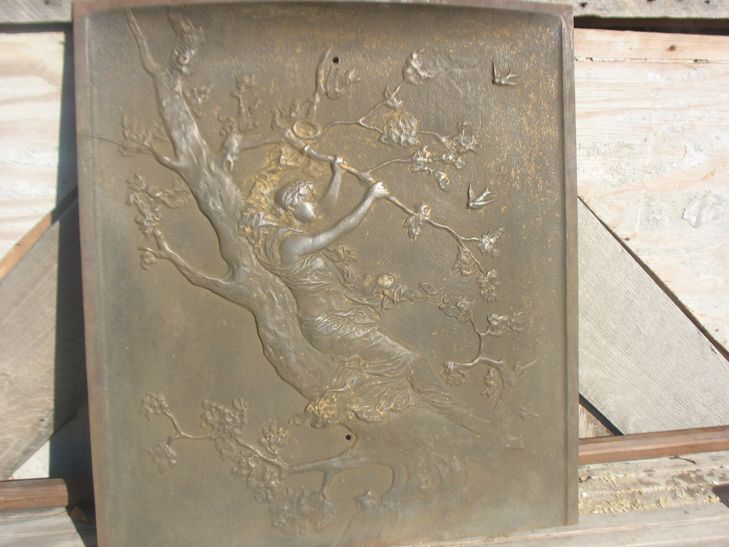 This is an absolutely gorgeous cast iron fireplace cover of a girl swinging high up in the branches of a tree with swallows flying in the sky behind her. Purely Victorian and oh so romantic. Very Heavy cast iron. Measures 26 1/2 inches tall X 2 feet wide.What a great piece in any room in the house as a wall hanging as it is or framed. A very special piece indeed.