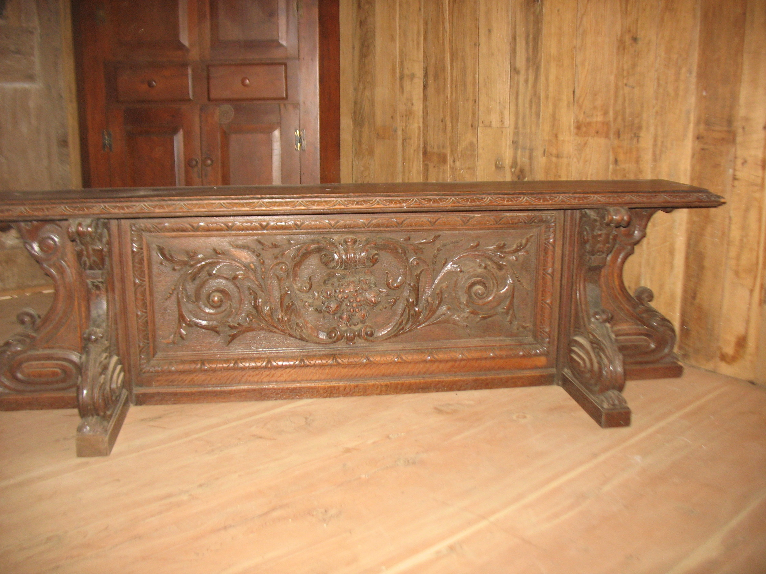 If you want an unusual piece this fills the order. Beautifully carved Victorian piece which measures 69 inches long X 16 inches wide from front to back and 22 inches tall. The shelf on top is18 inches wide. I used it at the end of my bed with pillows, but it can be hung as a shelf or as a seat with pillows or a cushion. Absolutely beautiful in detail.    Price: upon request
