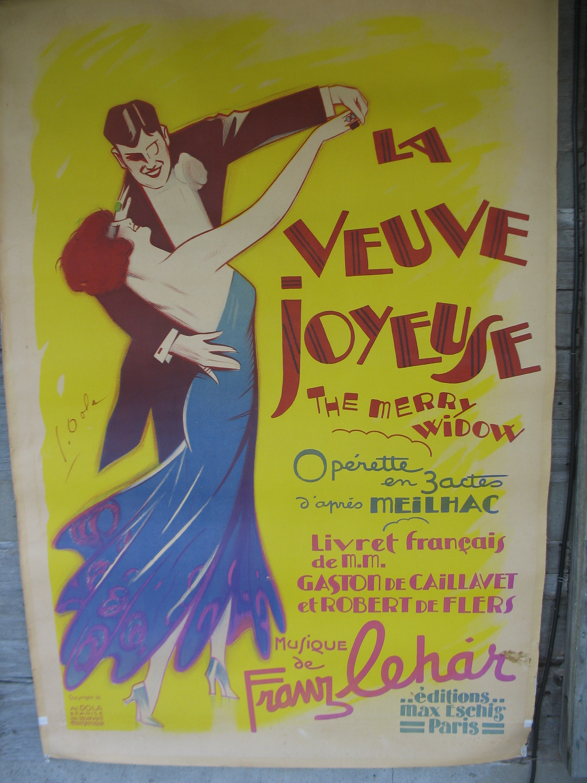 """Poster of """"The Merry Widow"""" the wonderful operetta by Franz Lehar. The colors are very vivid yellows, blues, and reds. It is a signed Dola who was a very popular poster artist in 1936 in France."""