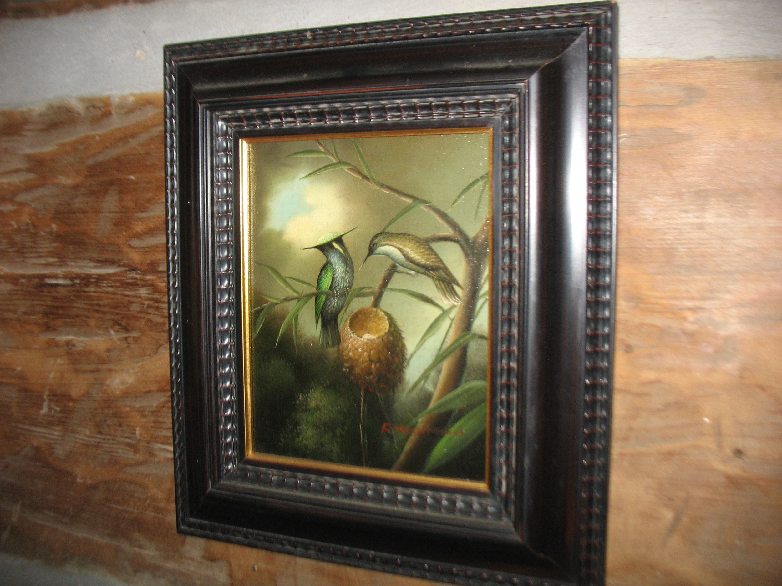 This is an oilpainting signed by the artist , R. Heartman inits original Victorian Frame. It is a lovely scene showing a pair of hummingbirds tending their nest .Overall measurements including frame are 14 inches wide X 16 inches in height. ca: 1890