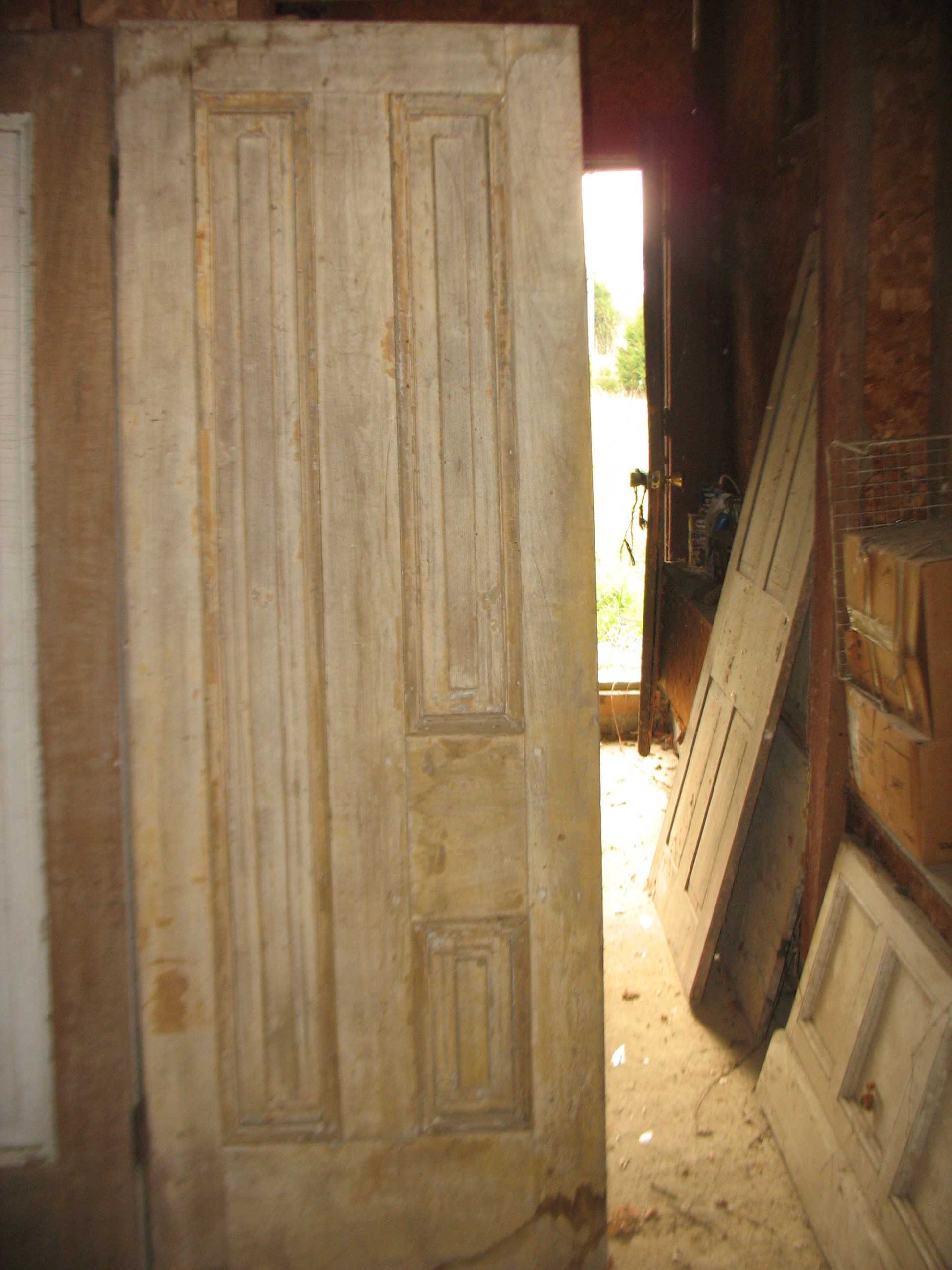 Wonderfully paneled pair of doors with original peeling white paint. 8 feet tall and 3 feet wide each door. That would make the pair 6 feet wide. They are of walnut and early 1800's.