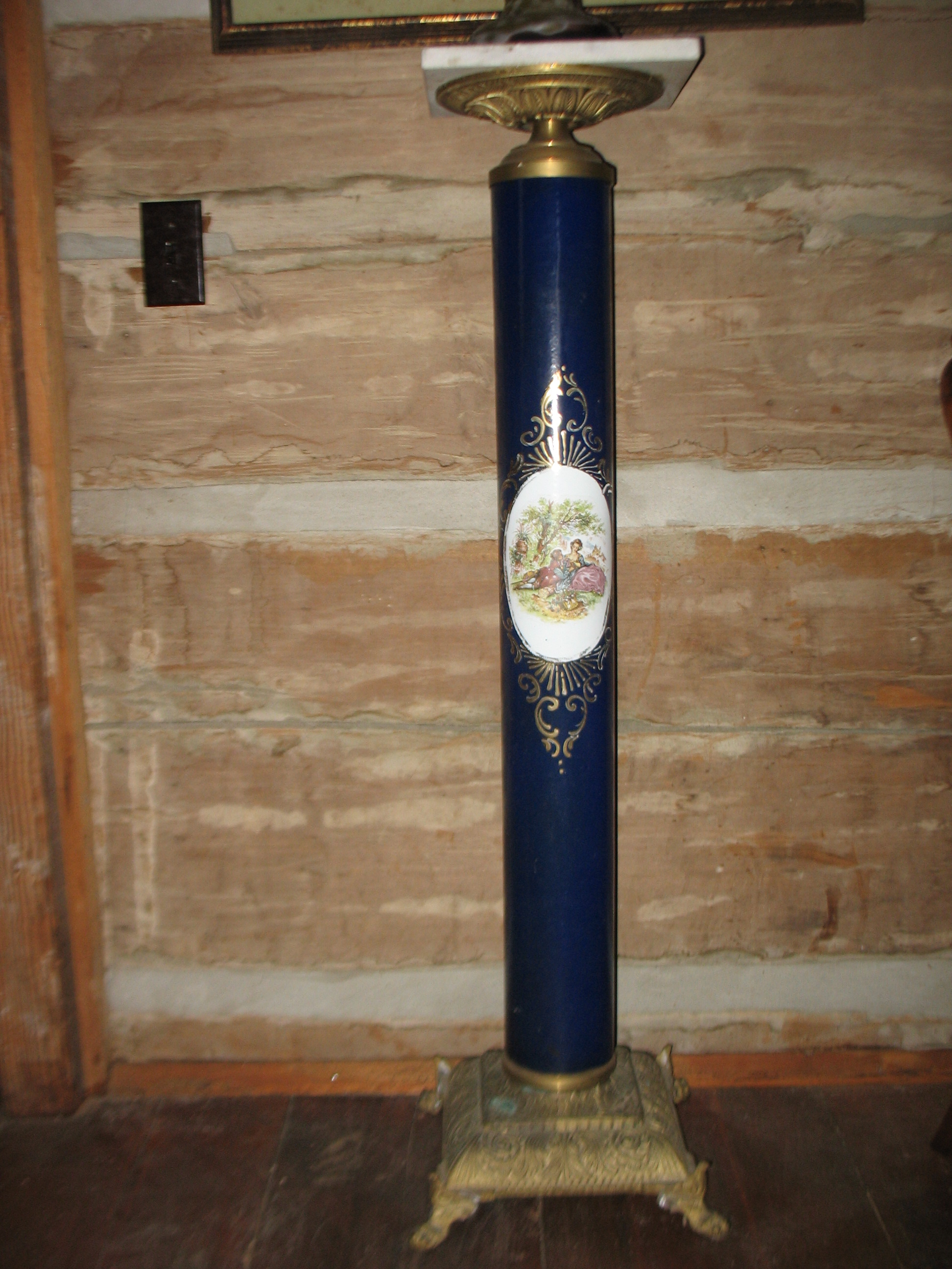 Brass Pedestal in Blue Cobalt with delicate French painting and decorative Brass base.    SOLD