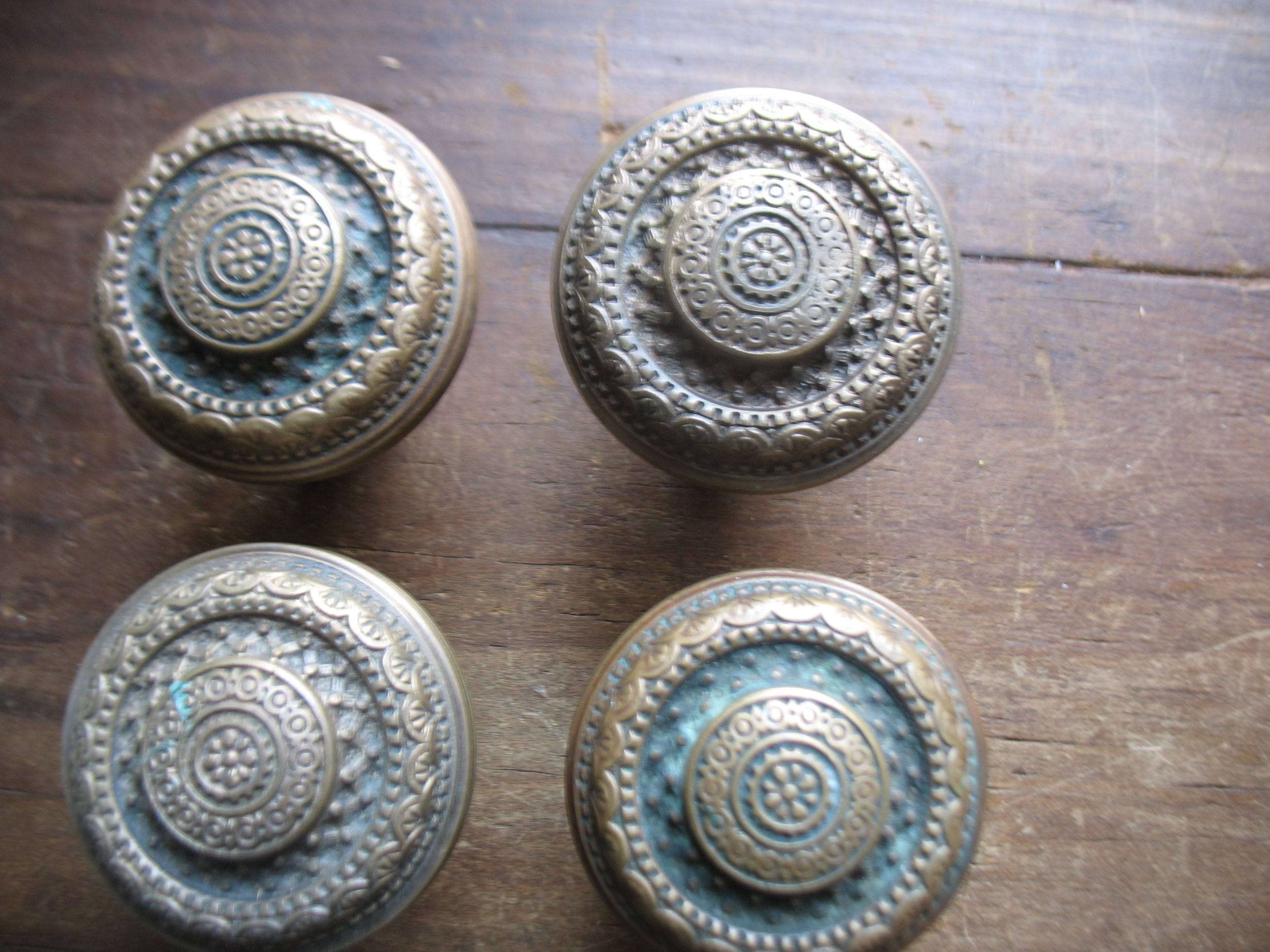 Close up of the four knobs in this set.