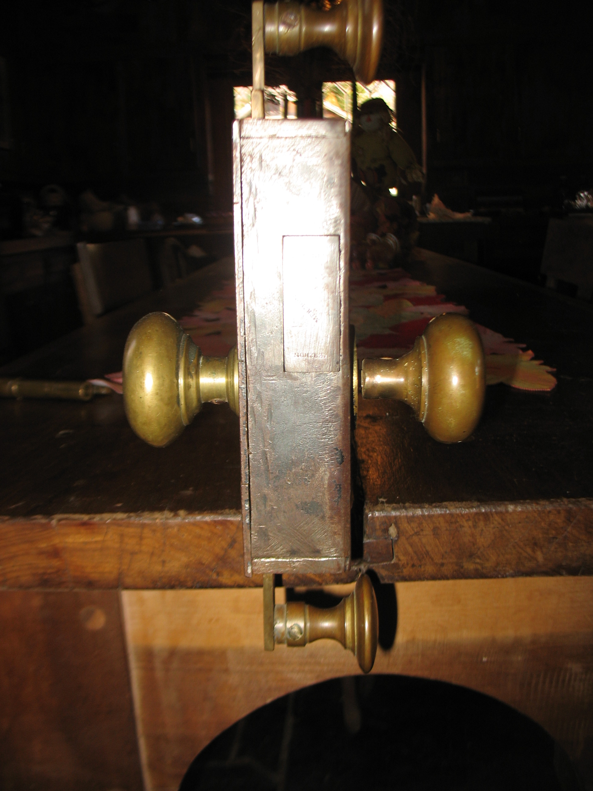 This shows the side of the lock  and its thickness.  The knob in the top and the knob on the bottom move up and down and locks into something.