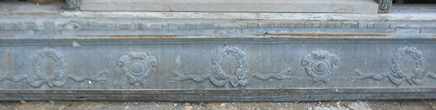This is a wonderful galvanized metal piece which measures 8 feet long and 14 inches wide. It is very unusual as it has round flower wreaths under which are ribbons and bows fashioned into the metal. Between the wreaths are symbols with plumes or scrolls on two sides and at the top. This piece would be fabulous as a border in a boudoir or ladies bath. It certainly makes a statement and is very feminine. Price upon request