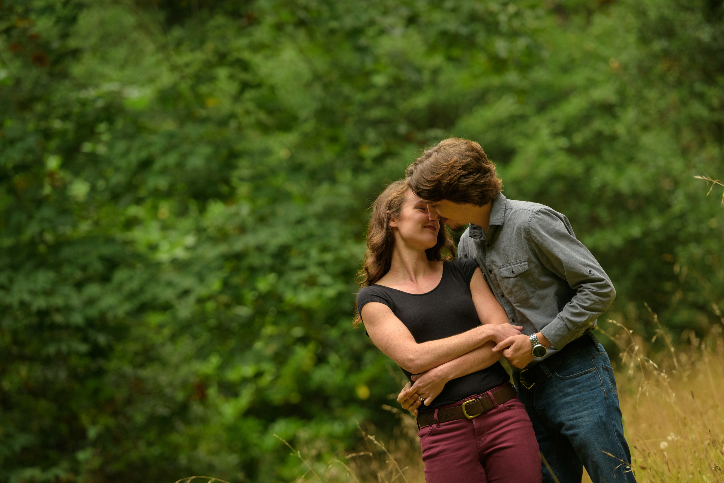 Couple kissing in the forest - Engagement Photos in Nisene Marks Forest in Aptos, CA - by Bay Area wedding photographer Chris Schmauch
