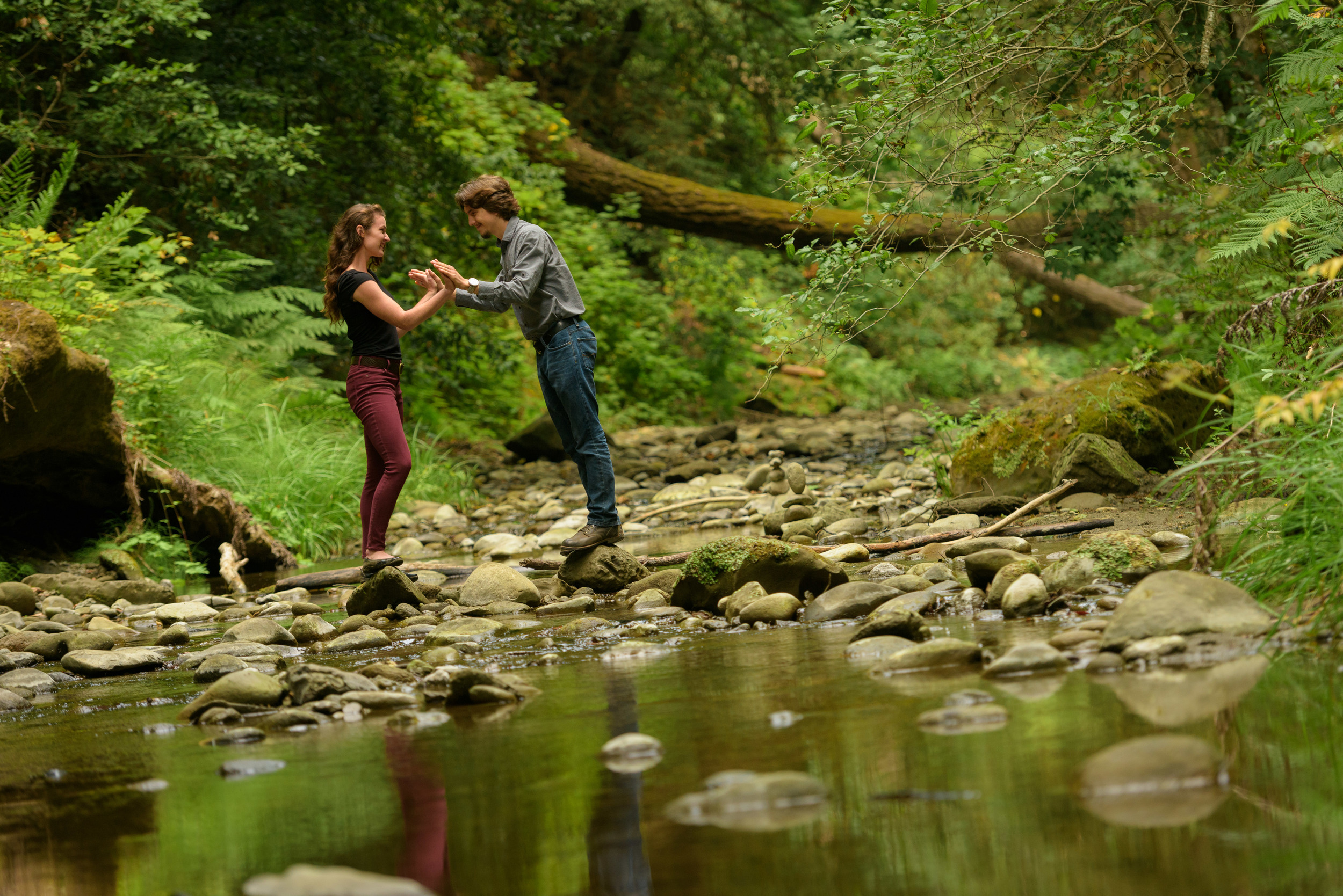 Couple touching hands in the creek - Engagement Photos in Nisene Marks Forest in Aptos, CA - by Bay Area wedding photographer Chris Schmauch