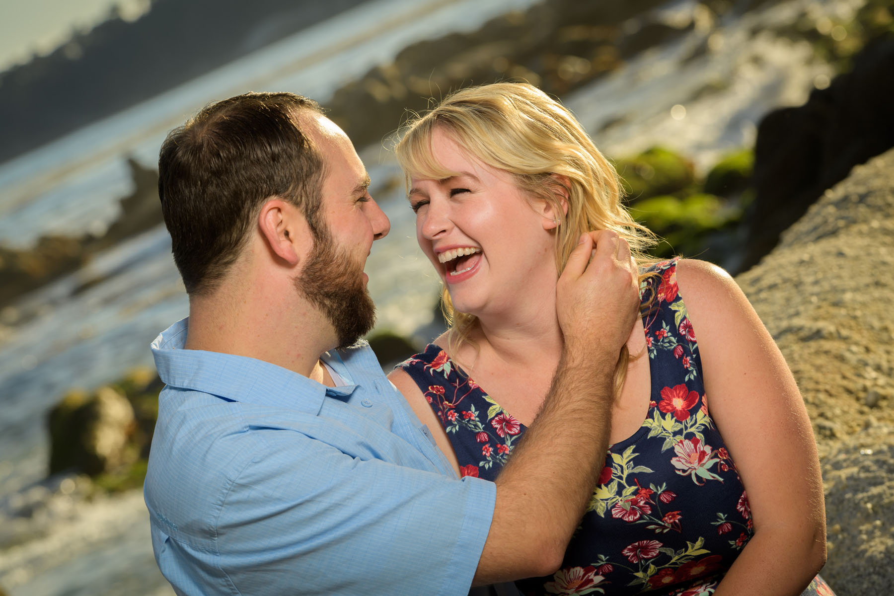 intimate couple, girl laughing - Stewart's Cove - Carmel Engagement Photography - photos by Bay Area wedding photographer Chris Schmauch