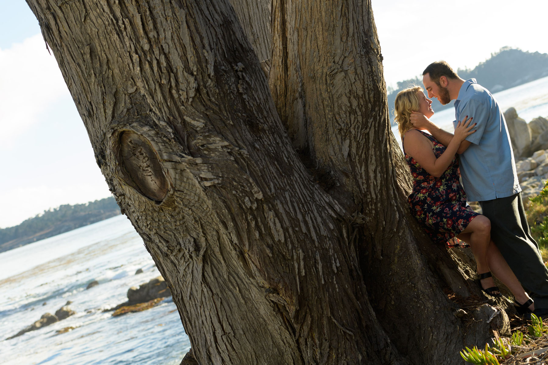 Couple next to a tree - Stewart's Cove - Carmel Engagement Photography - photos by Bay Area wedding photographer Chris Schmauch
