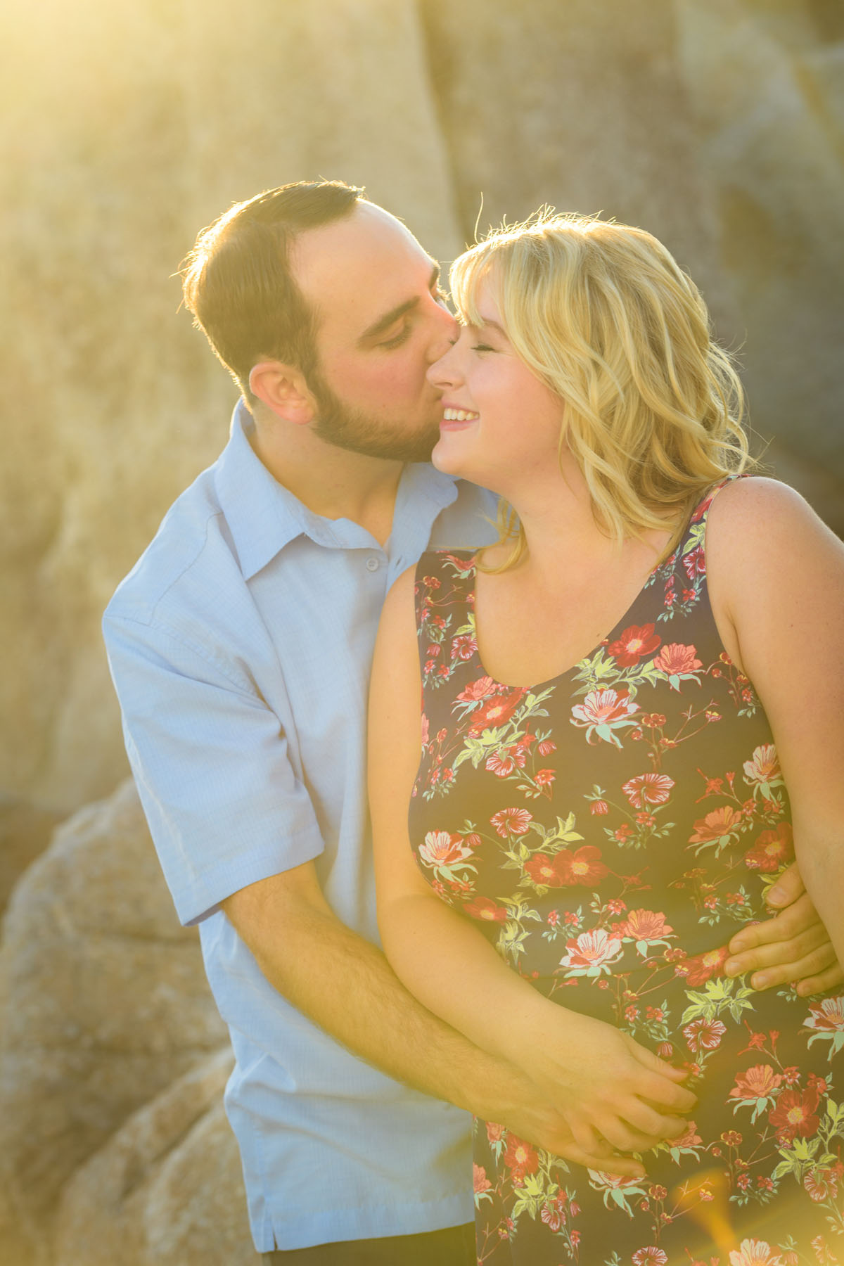 couple kissing with sun flare - Stewart's Cove - Carmel Engagement Photography - photos by Bay Area wedding photographer Chris Schmauch