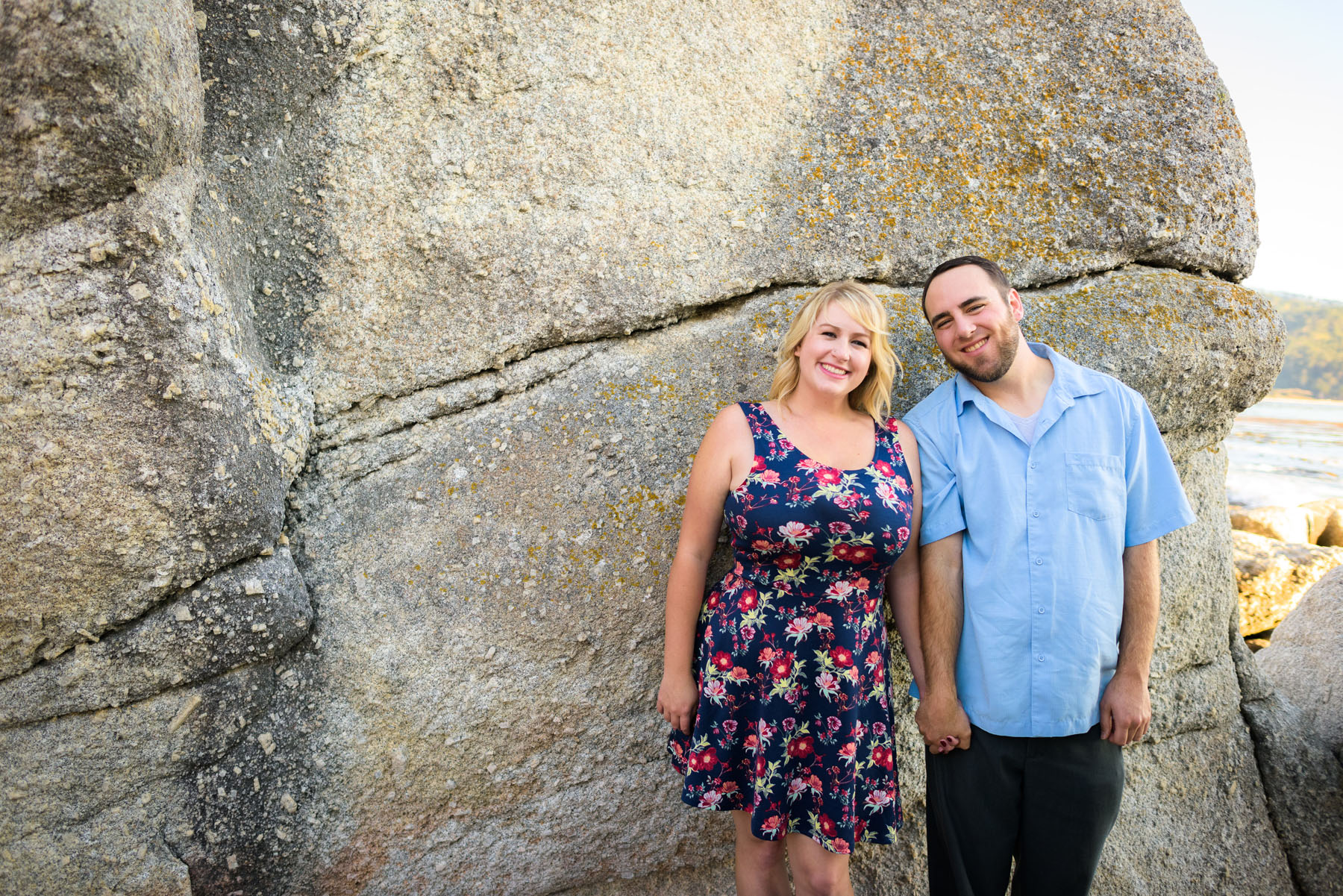 couple holding hands with back to ocean rock - Stewart's Cove - Carmel Engagement Photography - photos by Bay Area wedding photographer Chris Schmauch