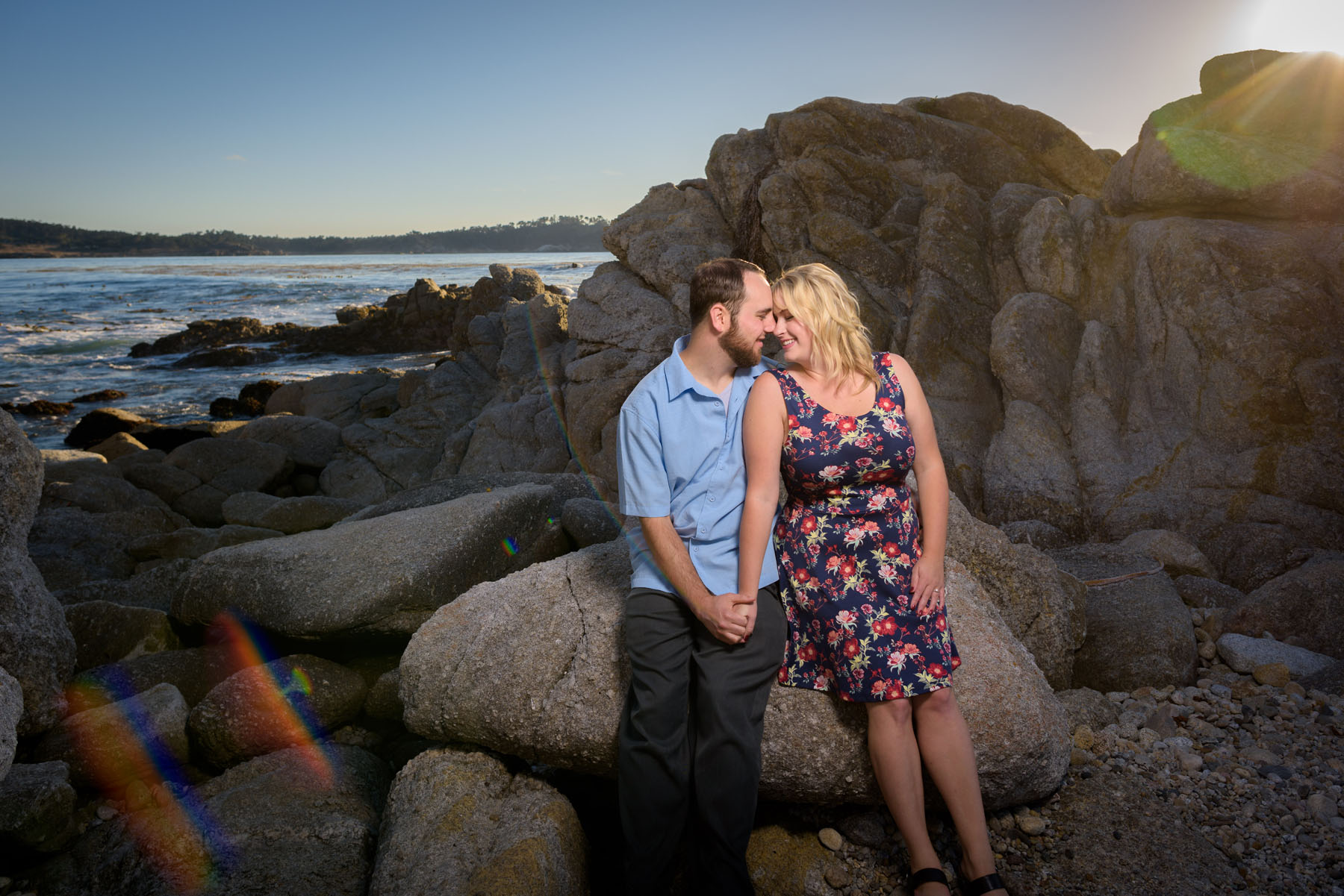 couple cuddling on beach - Stewart's Cove - Carmel Engagement Photography - photos by Bay Area wedding photographer Chris Schmauch