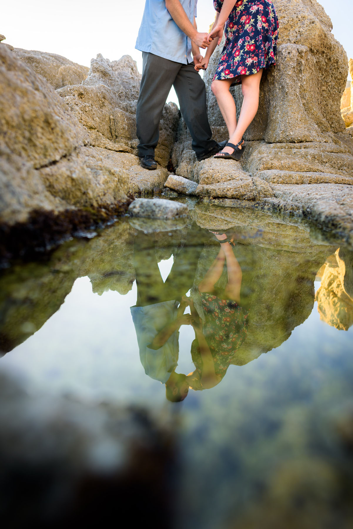 reflection of kissing couple in tidepool - Stewart's Cove - Carmel Engagement Photography - photos by Bay Area wedding photographer Chris Schmauch