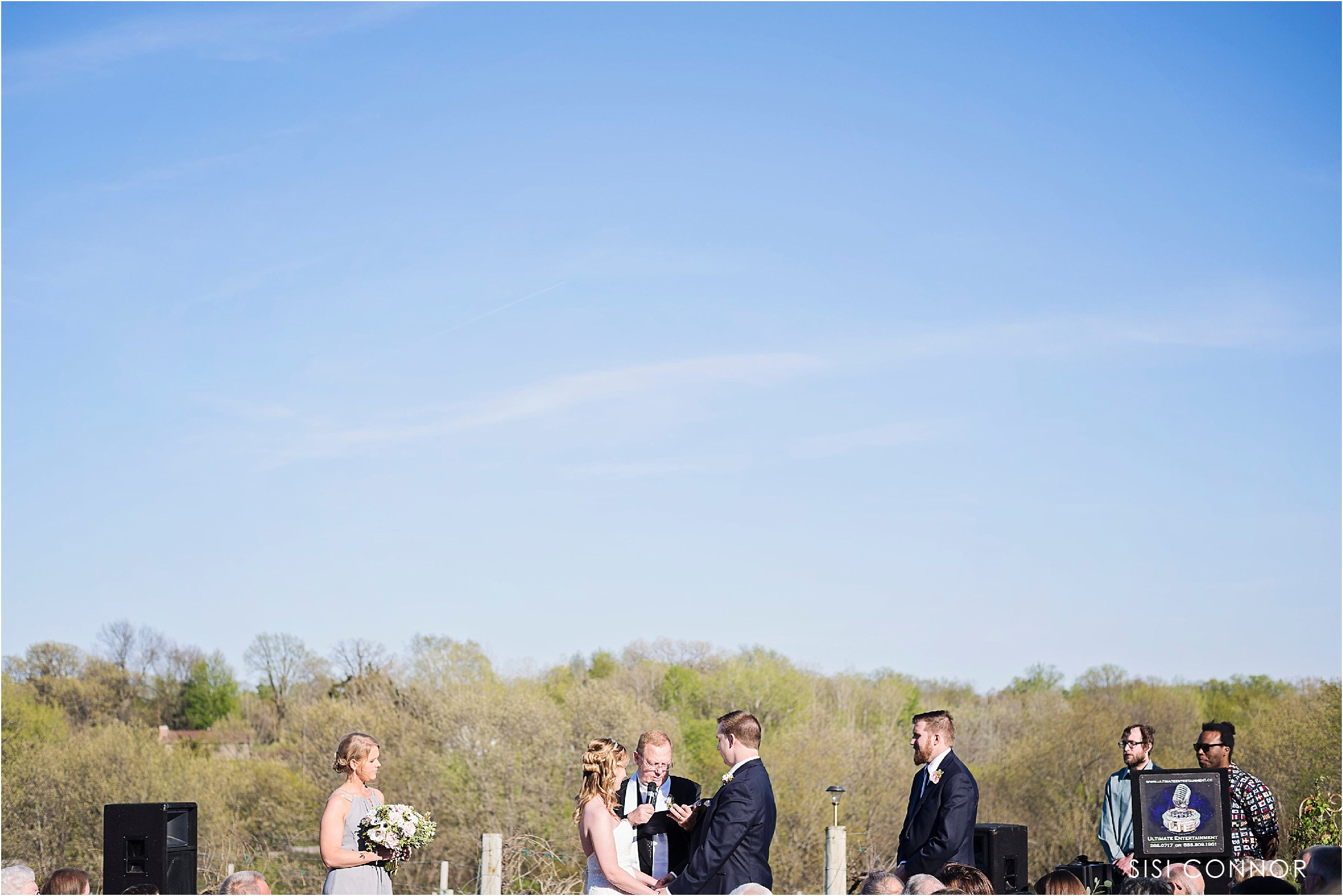 Wedding Ceremony outdoors at the Cedar Ridge Winery in Swisher, Iowa