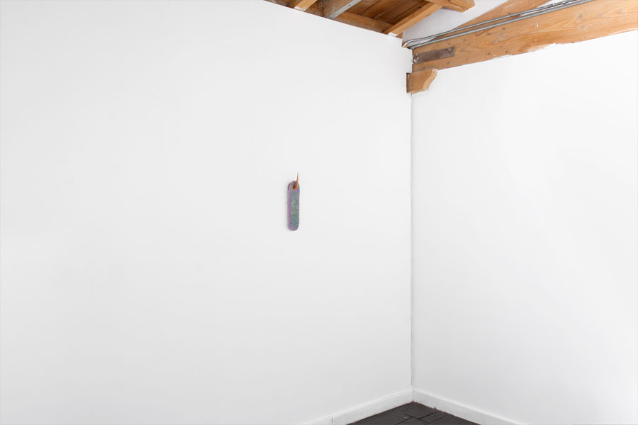 "TS I KK U N D, Fiberglass reinforced plaster, pigment, carved basswood, 14"" x 4"" x 3"", 2015 (image courtesy  artist website )"