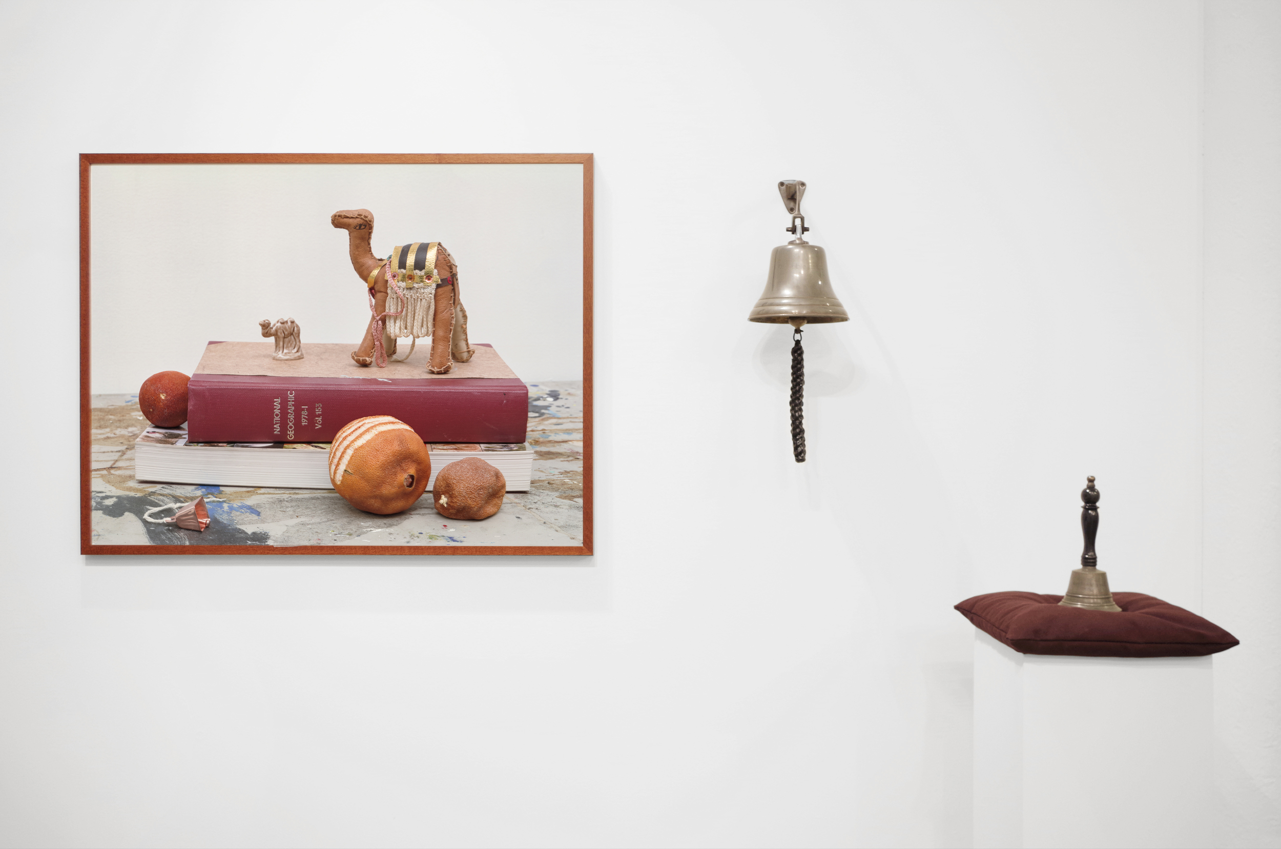 LEFT Diorama, C print. 18 x 24 in, ed. 3, 2016  RIGHT  Oh Noble Heart, Bethink Your End , Brass bells with custom engraving, buckwheat, cotton, plinth, rope, 2016