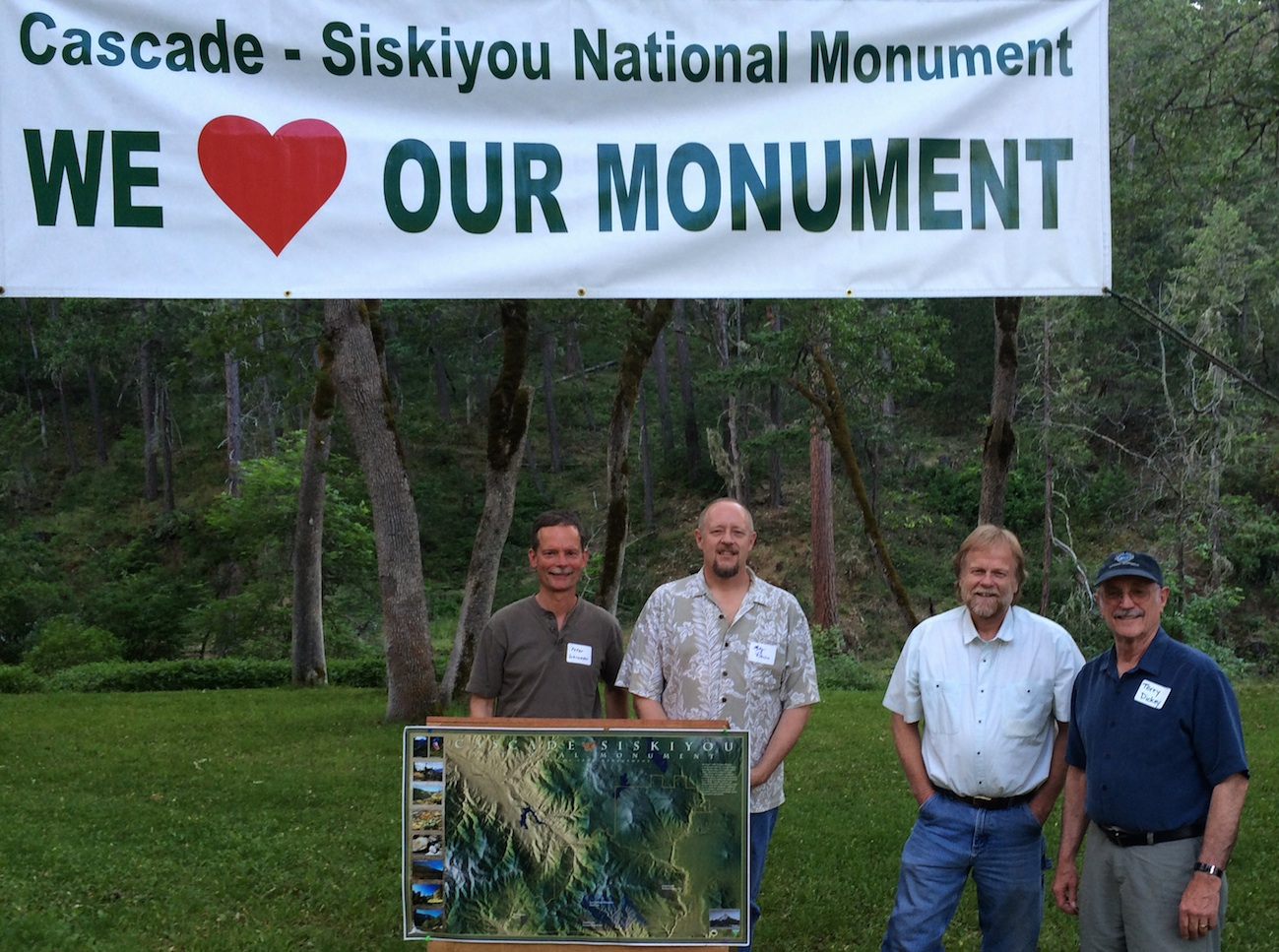 Dave Willis (2nd right) welcomes Friends of Cascade-Siskiyou National Monument Board Members Peter Schroeder, Marty Peterson and Terry Dickey at the 15th Anniversary gathering. Friends of CSNM 2015 Photo.