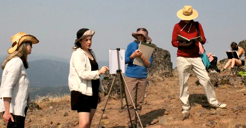 Sarah Burns,  (2nd from left) demonstrates a landscape sketch at Hobart Bluff, Cascade Siskiyou National Monument.