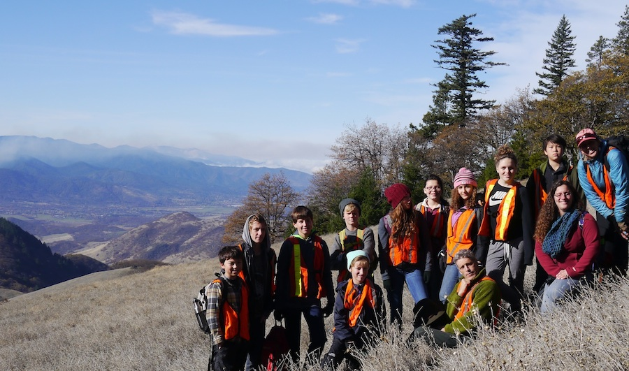 Fall in the Field school group learns about Cascade Siskiyou National Monument biodiversity from SOU Environmental Education graduate student leader. T Dickey 2016 image.