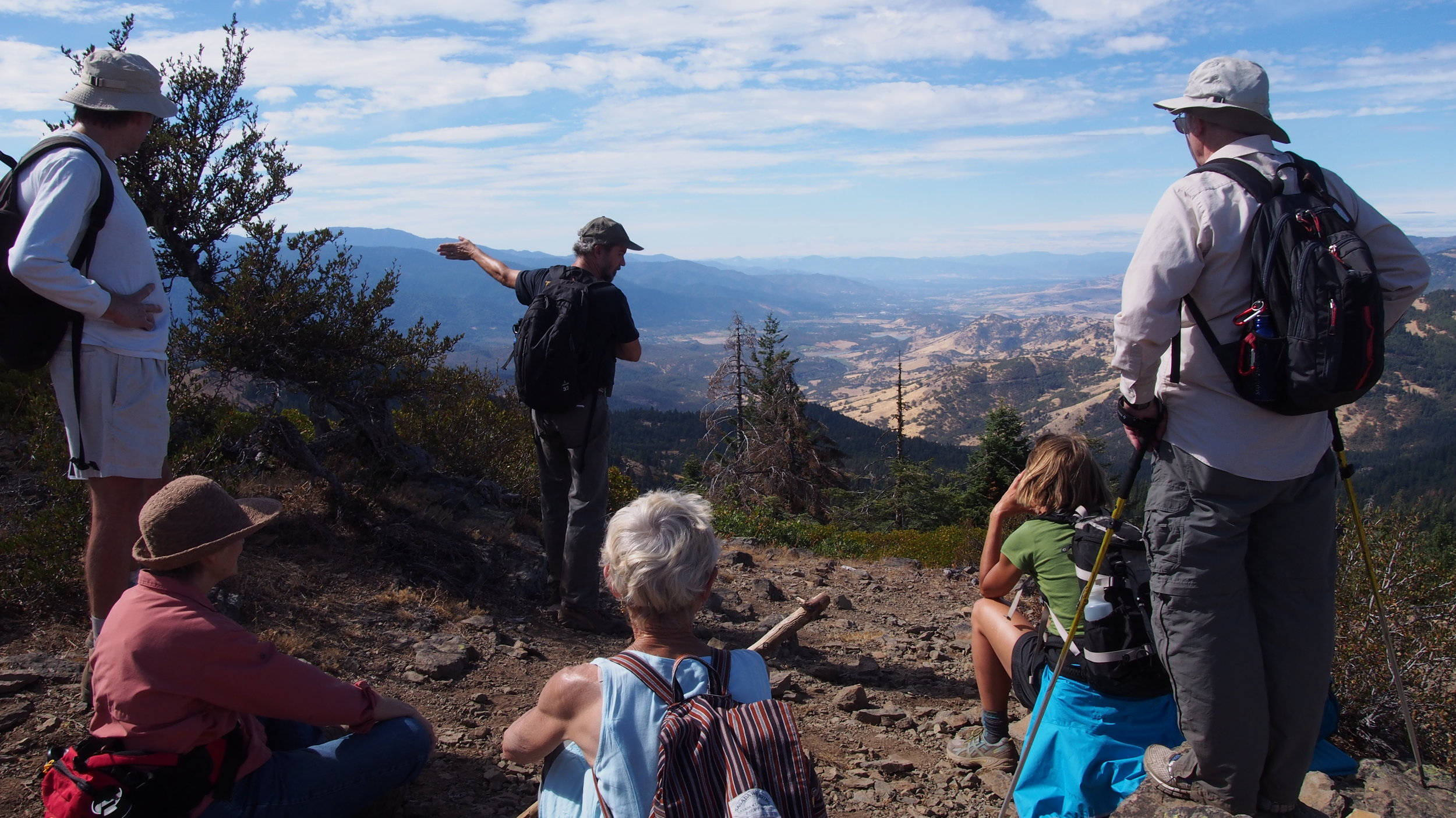 Poet-ornithologist  Pepper Trail (r) orients hikers to the view from the top of Hobart Bluff.