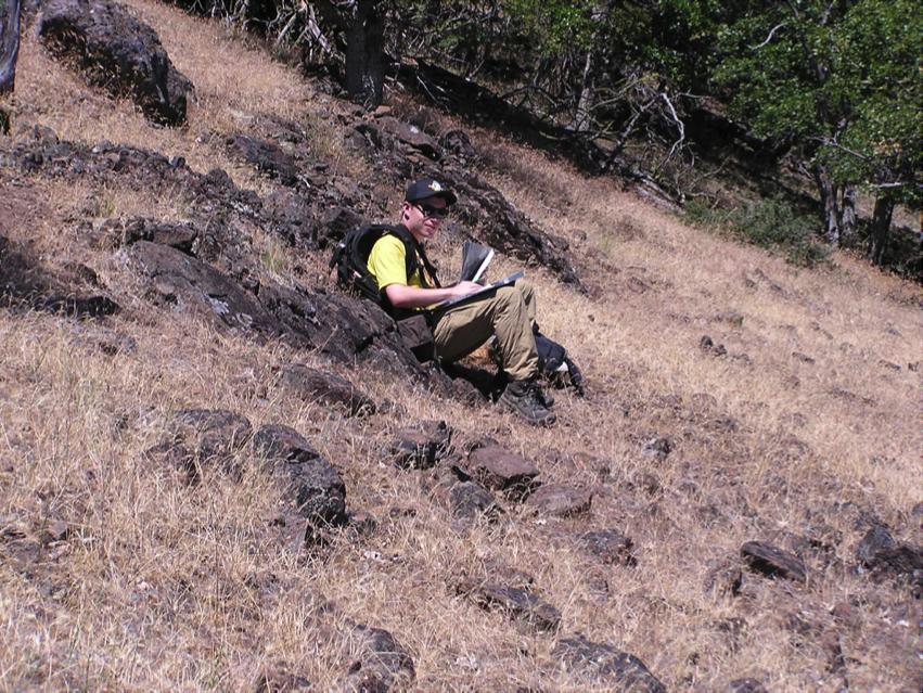 Kieran McCann plots location on map using a GPS unit. Photo by Jad D'Allura