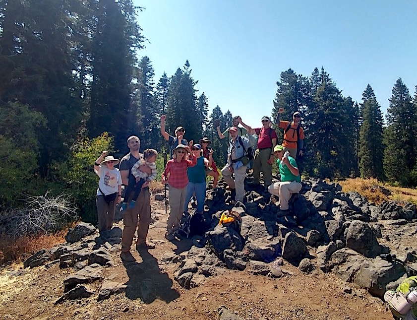 Geologist Jad D'Allura, SOU professor emeritus (with red hat, right center), shows Hike and Learn group the summit of Grizzly Peak. Heather Wilson photo