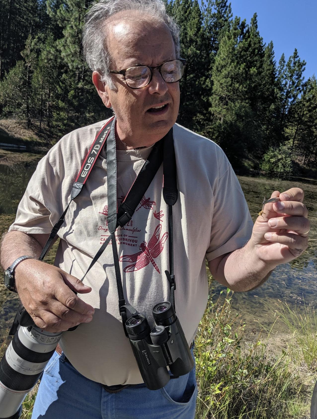 Norm Barrett, BioBlitz organizer, identifies a dragonfly in hand. Photo by Shannon Browne.