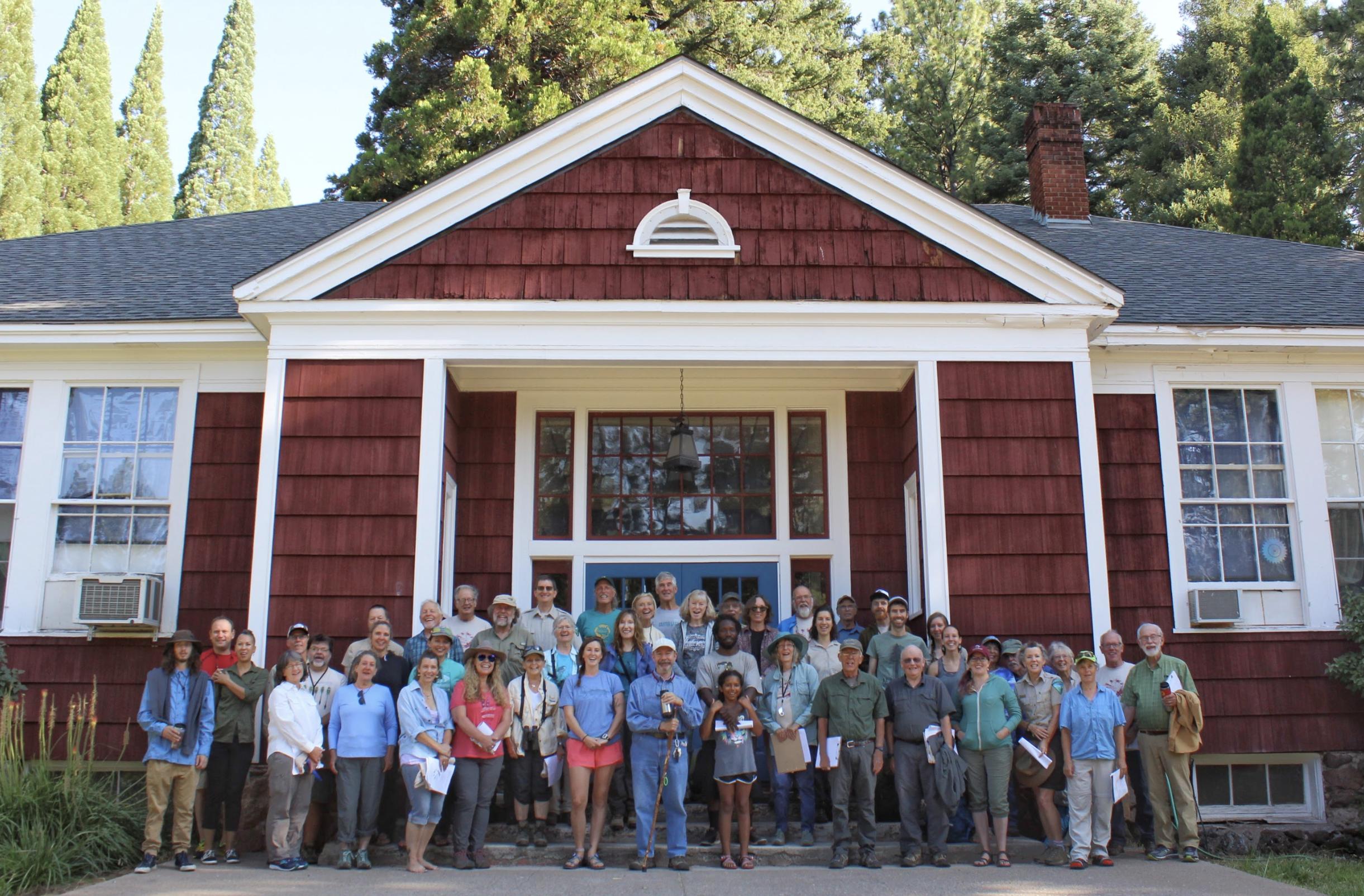 Citizen Scientists pose in front of Pinehurst School.