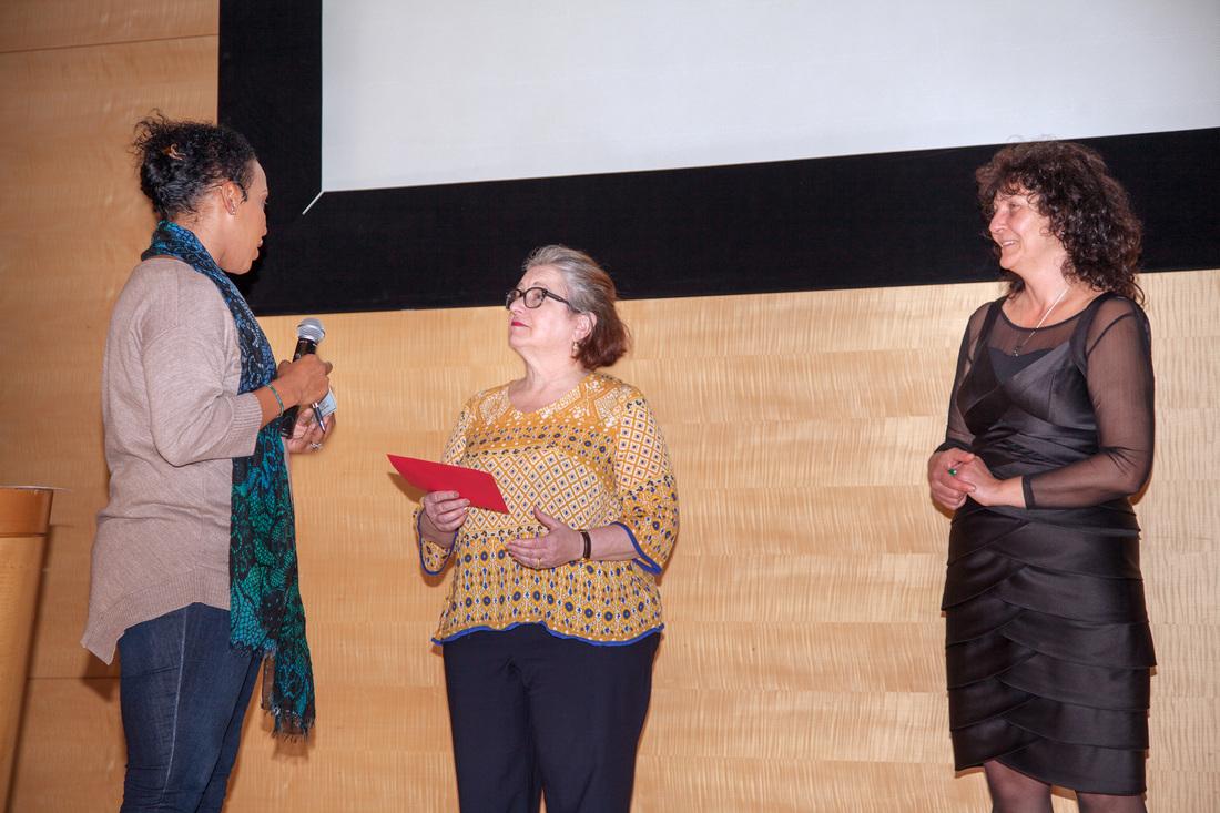 Debra Surkin handing the scholarships to Sarai T. Smith-Mazariegos.