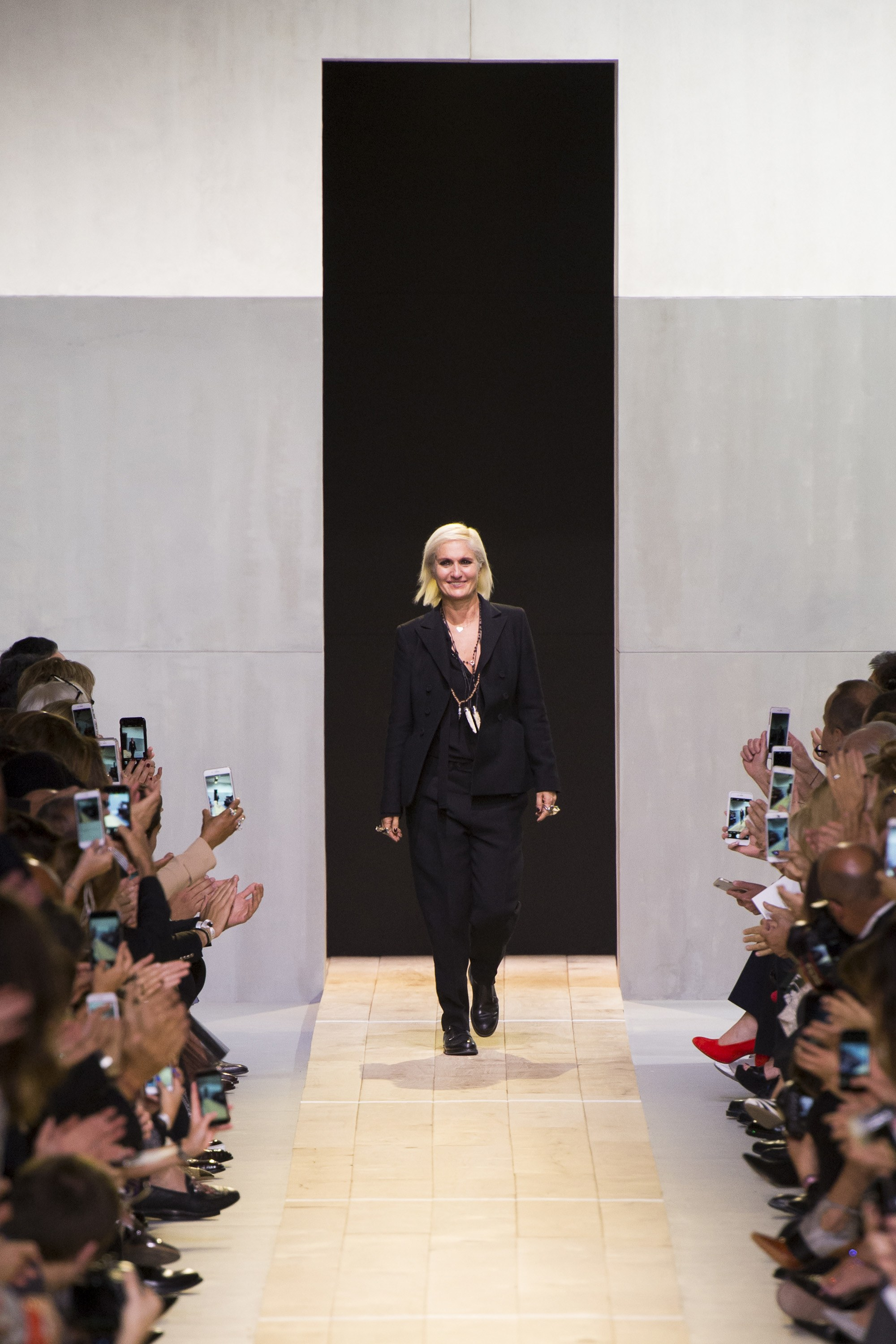Maria Grazia Chiuri  takes a bow at Dior SS17.