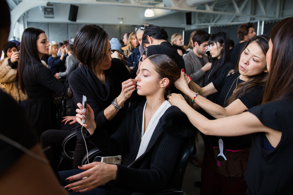 All hands on deck as models'hair and makeup is prepped for the runway.