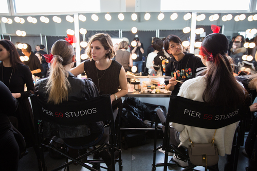 It takes an army.  Beauty teams work backstage to get models runway-ready.