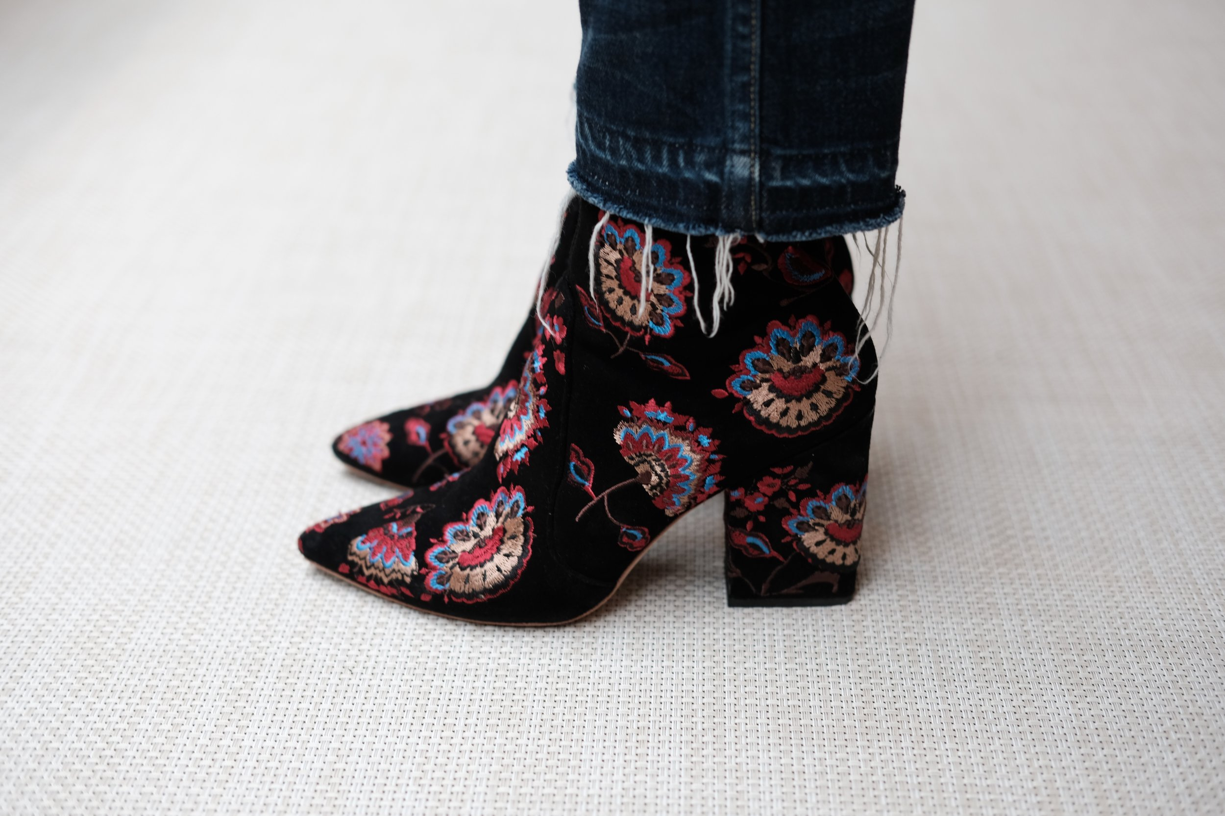 LR's marketing maven Louisa wears the  Isla Slim Ankle Bootie in Black Floral  and  denim by AMO, available here.