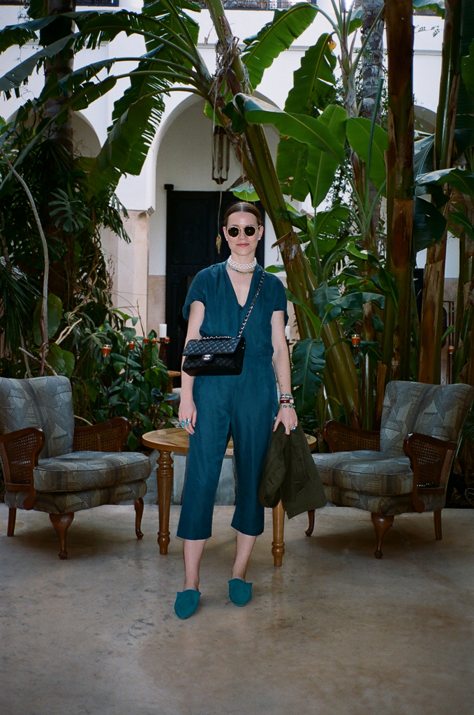 Zero Maria Cornejo jumpsuit, Fry Powers pearl choker, Chanel handbag.