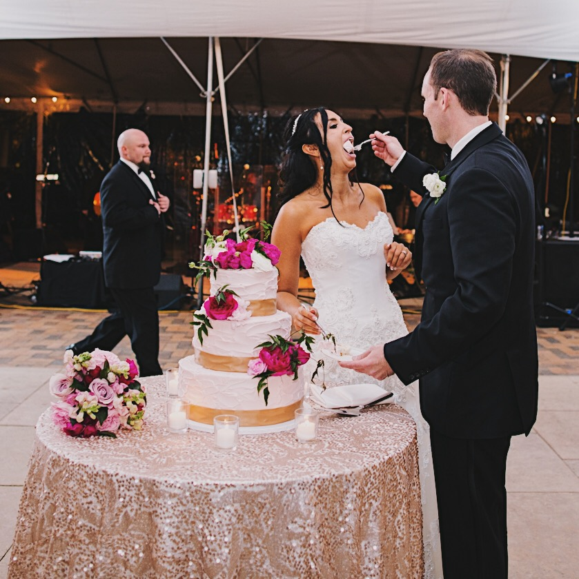 Yeah, that's me being a lovely example of not practicing mindful eating! Or am I? 3 bite rule?! Side note: I love the dapper groomsman strutting across the floor! Photo by Kristin LaVoie