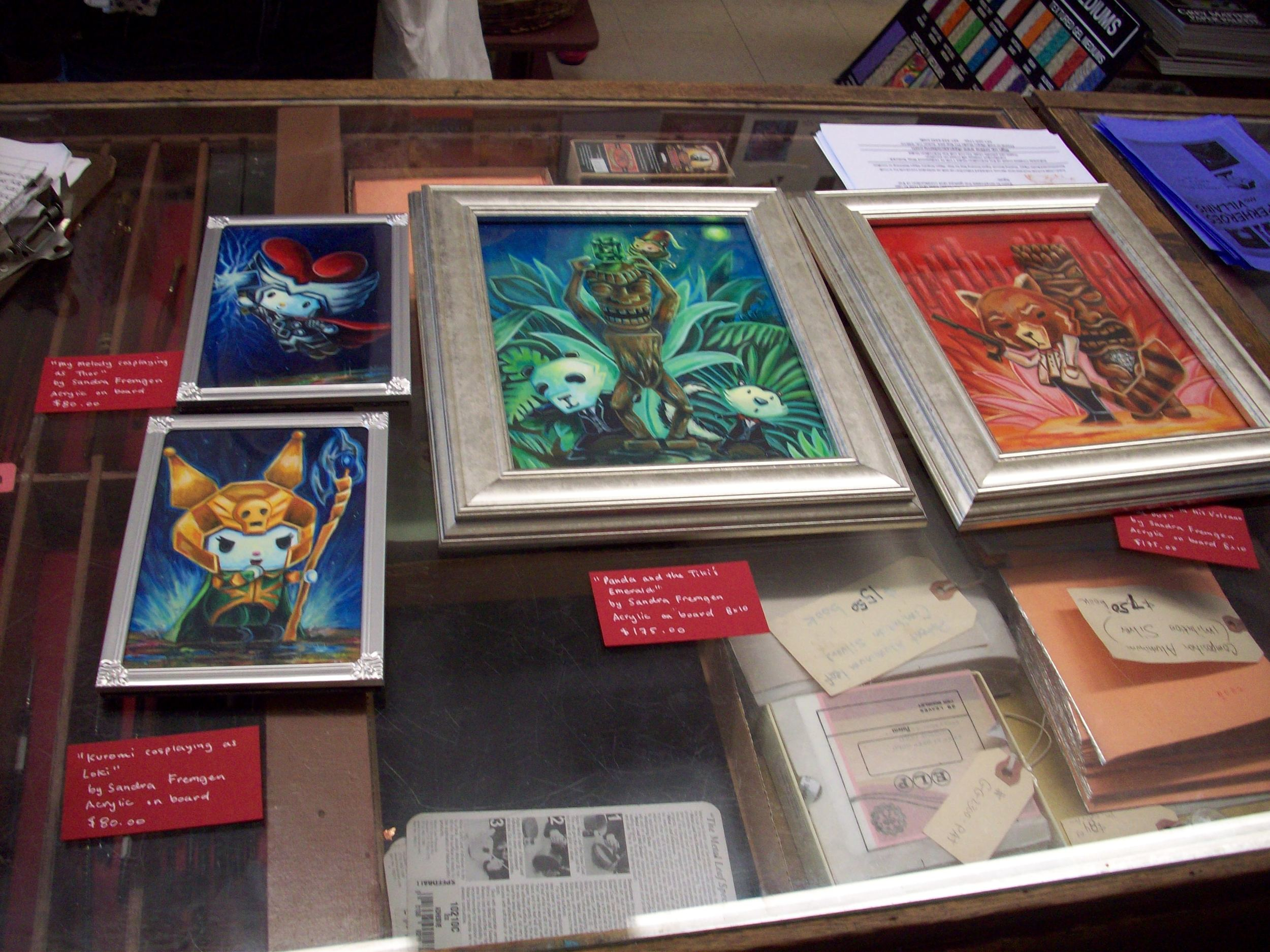I brought over my artwork on Saturday to the store and filled out cards describing the art! I loooooove the silver frames i got at Micheal's Arts and Crafts