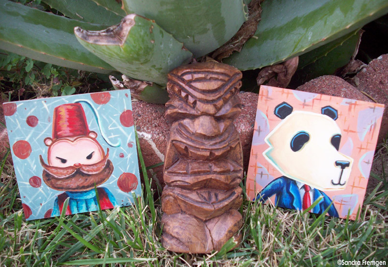 """""""Panda Square"""" and """"Fez Monkey Square"""" pose with my little Tiki from Hawaii in my backyard. The scale worked out well, don't you think?"""