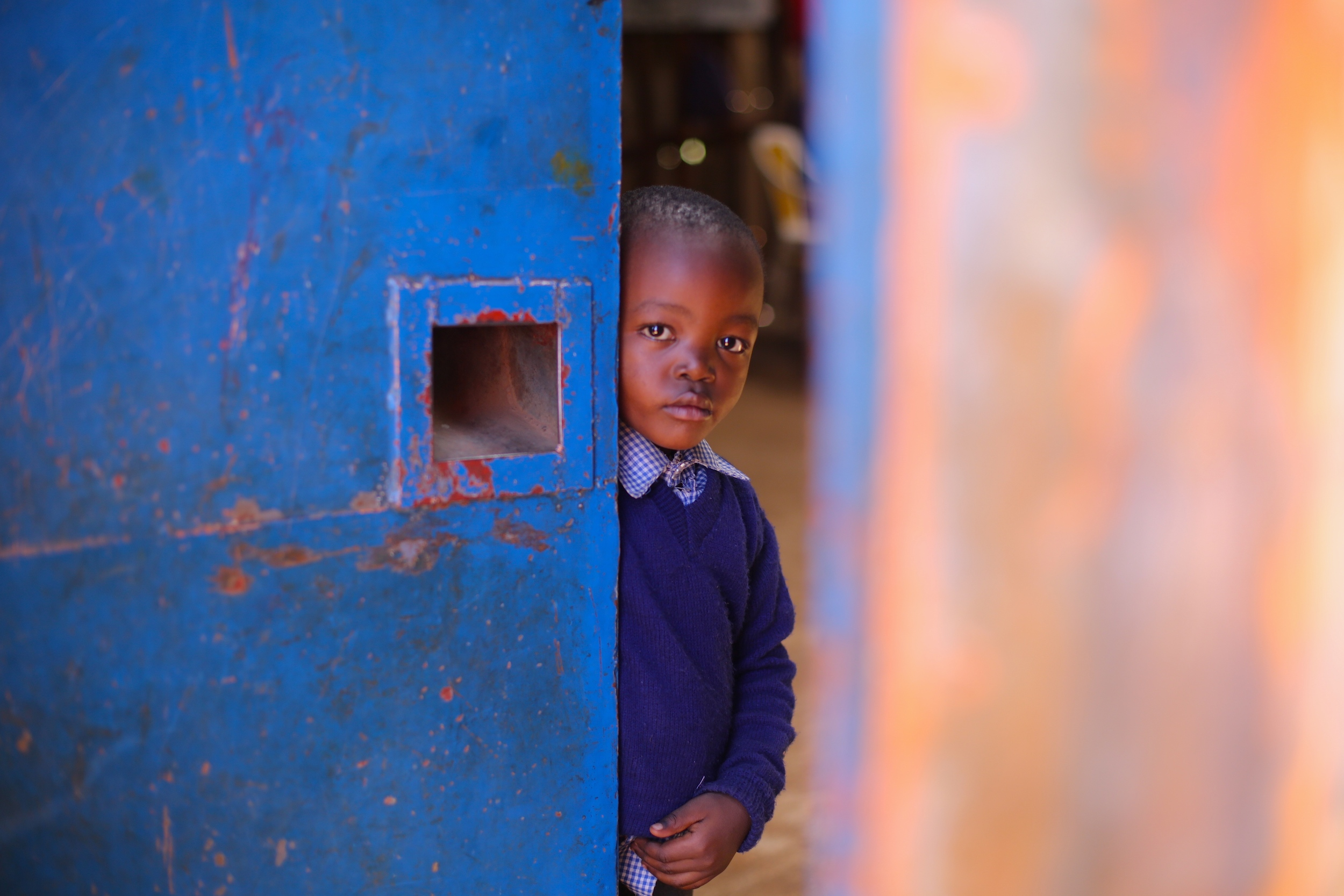 A student in Kibera takes a break from studying