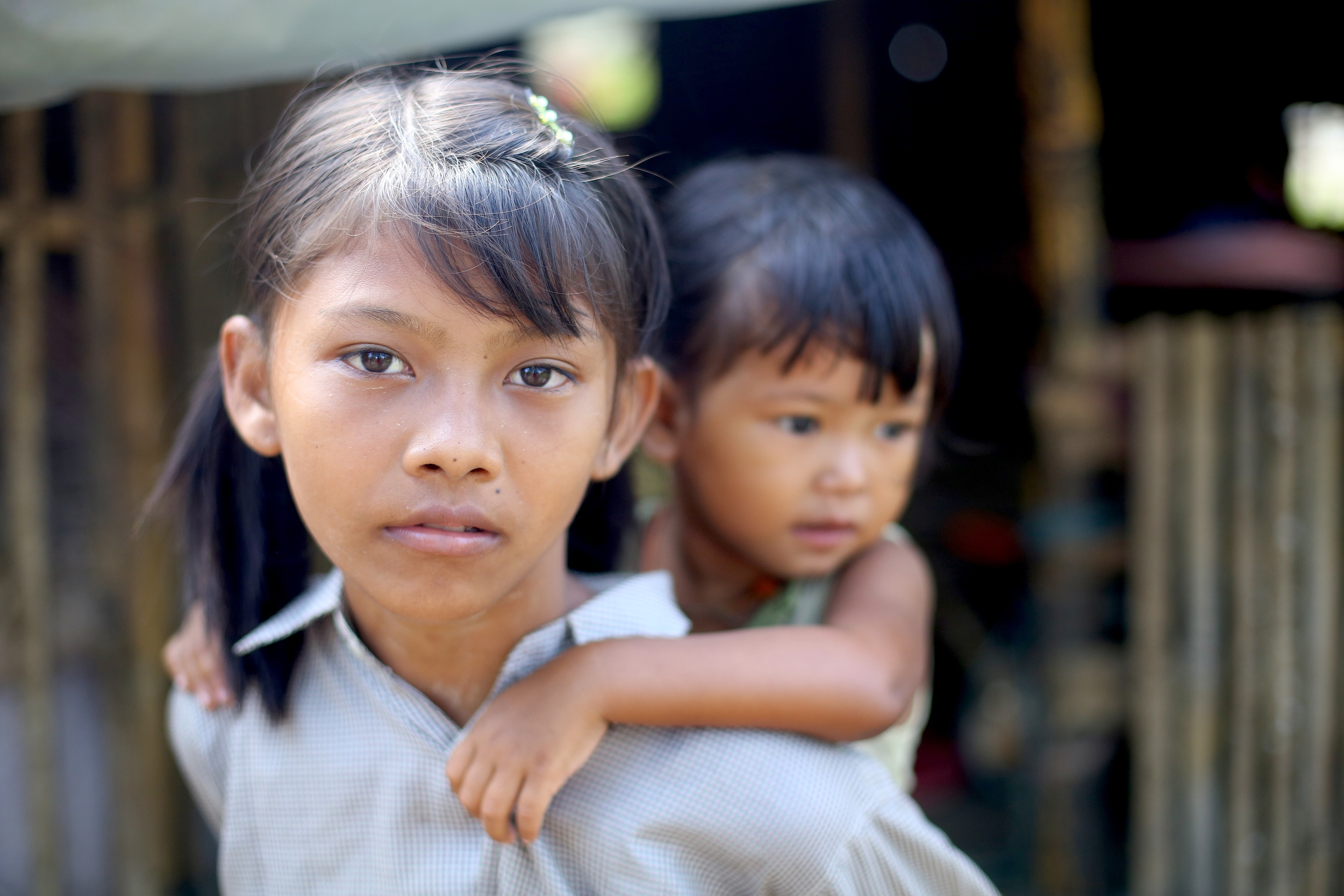 Ei Ei hitches a ride on her sisters back in Myanmar
