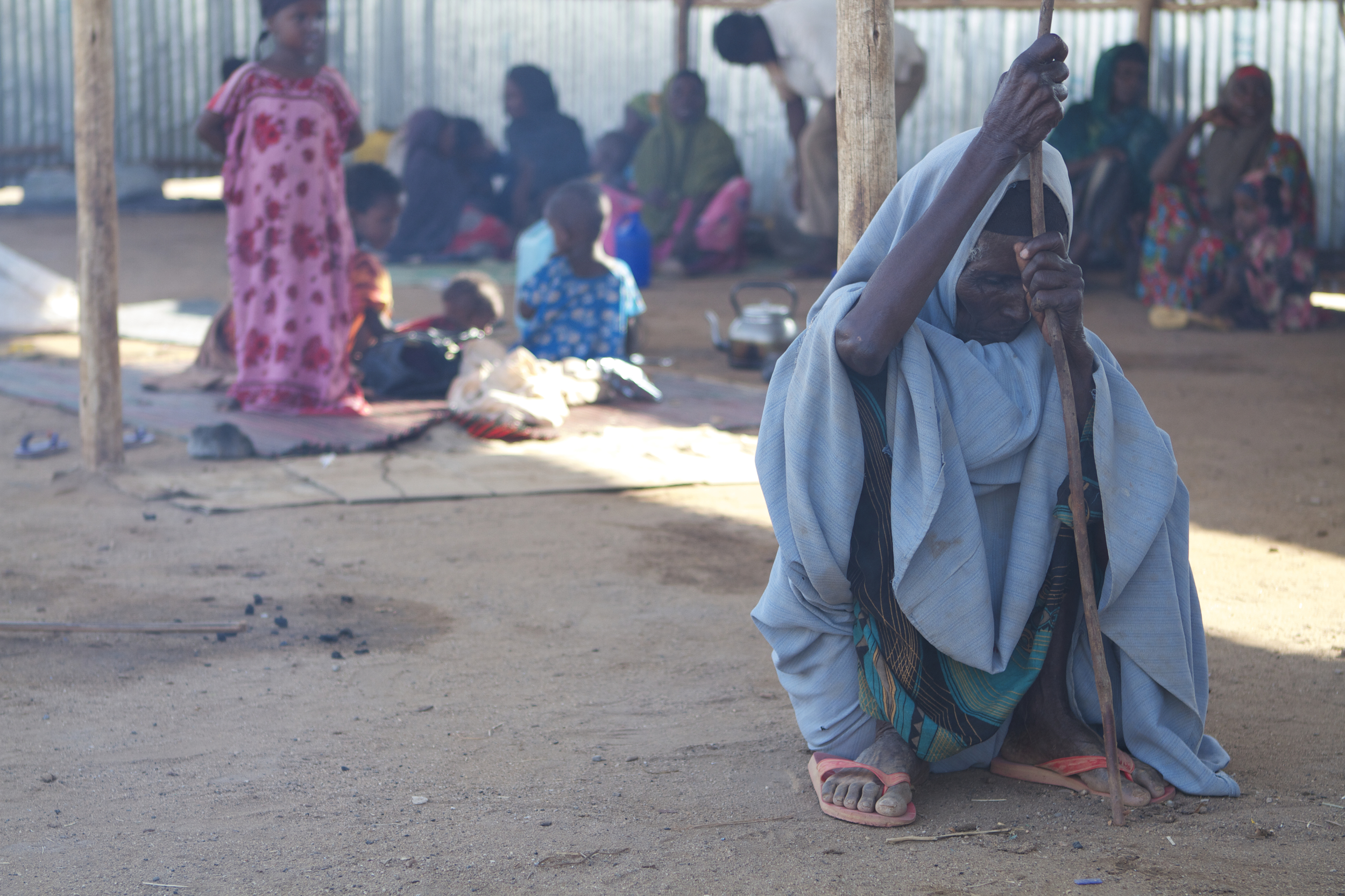 An elderly Somali woman rests at the reception centre at the Dolo Ado refugee camp in Ethiopia