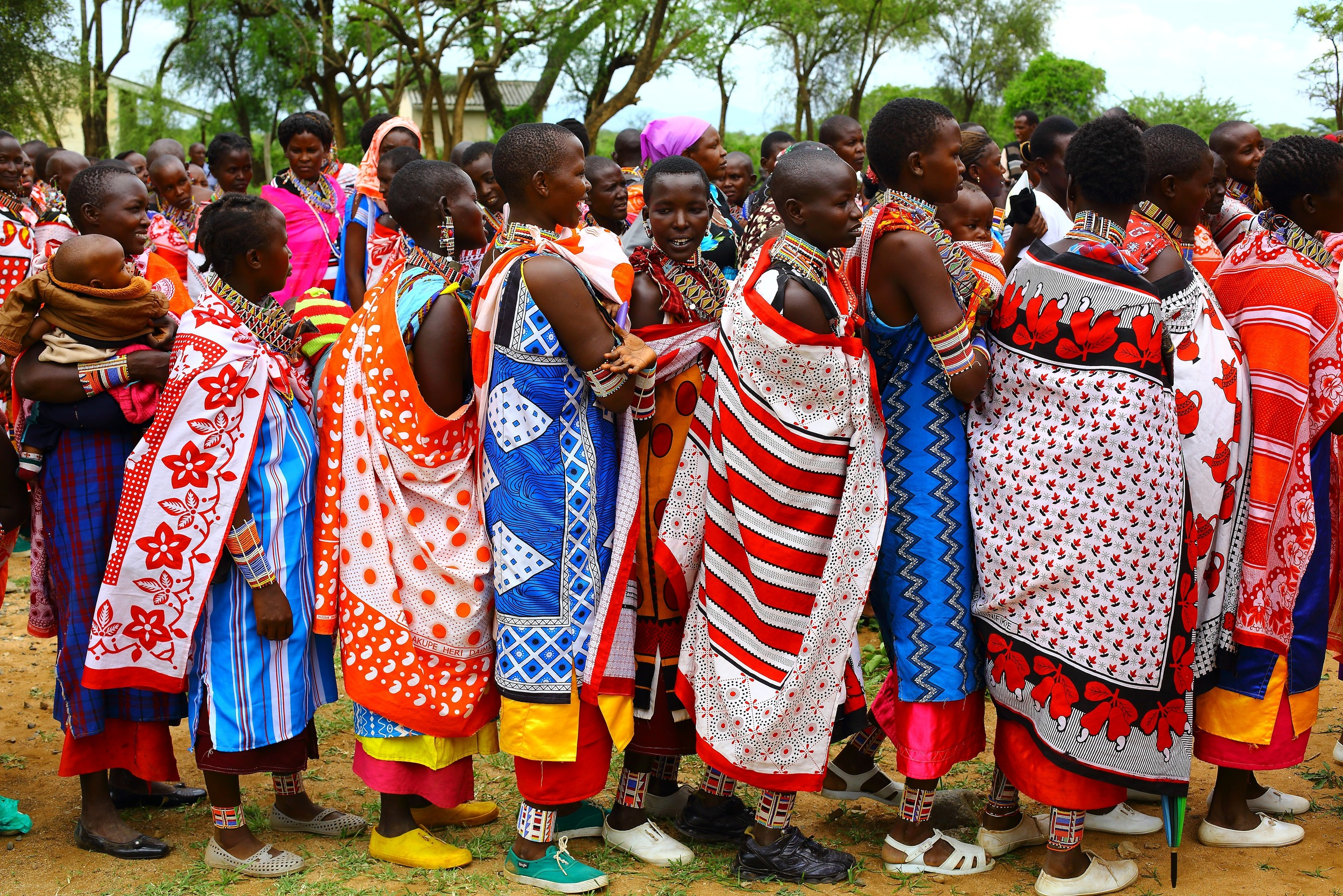 Maasai women queue up to vote for their preferred candidate in Kenya's election