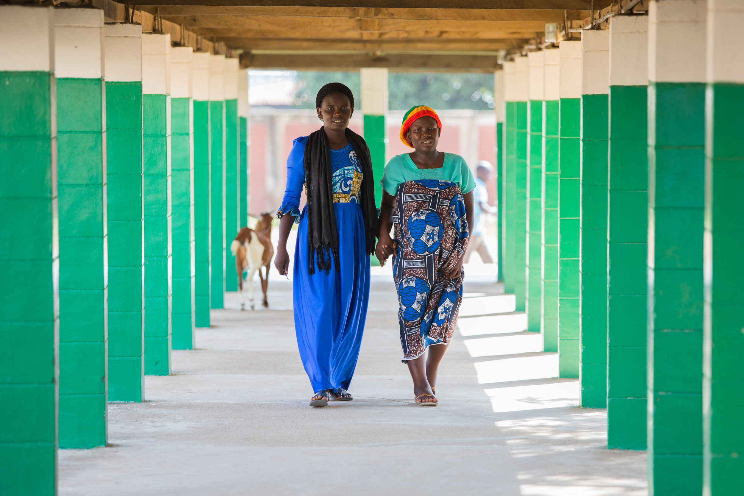 A woman helps her pregnant friend in a hospital in Adamawa state, Nigeria