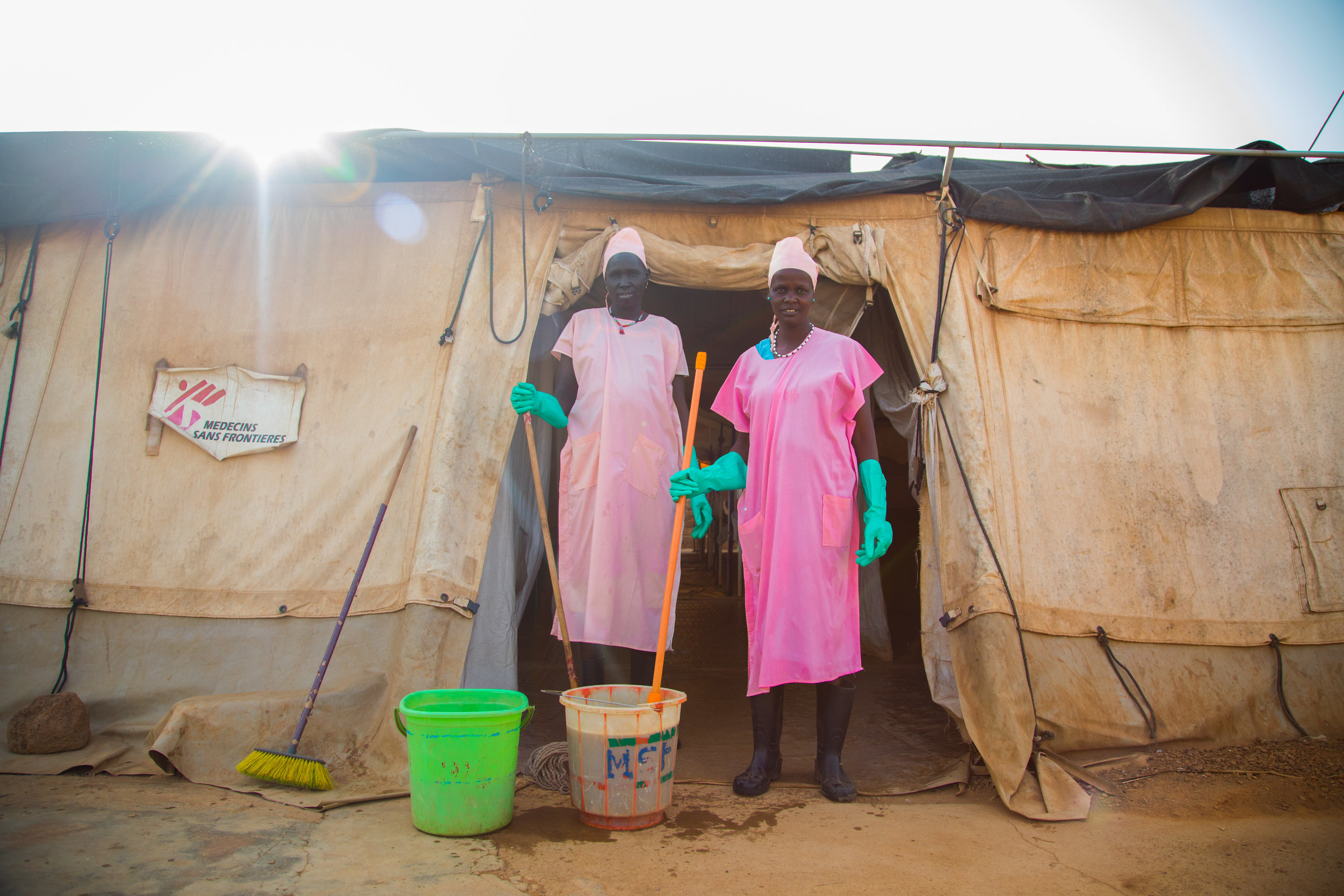 Two cleaners outside an MSF run hospital in Aweil, South Sudan