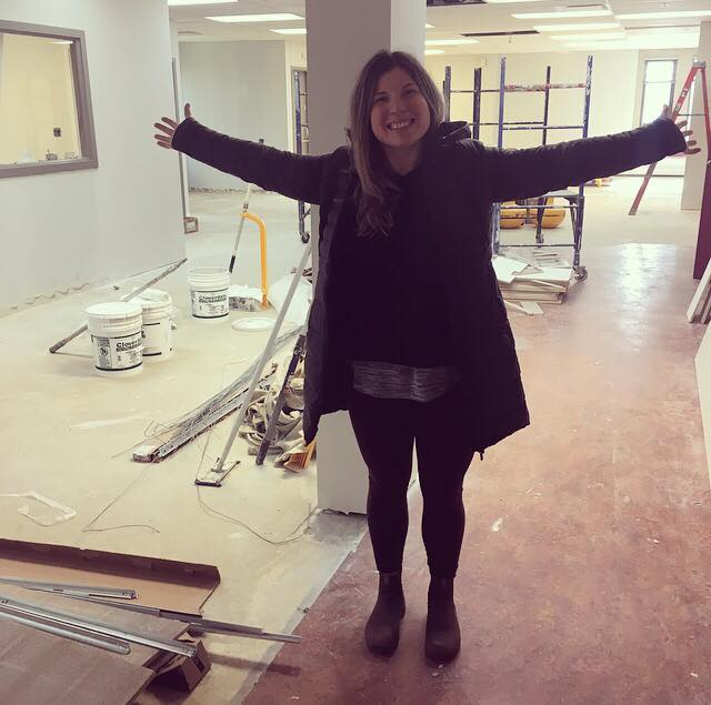 Alannah, MOVE's Facilities Coordinator, visiting our new location during the construction phase.