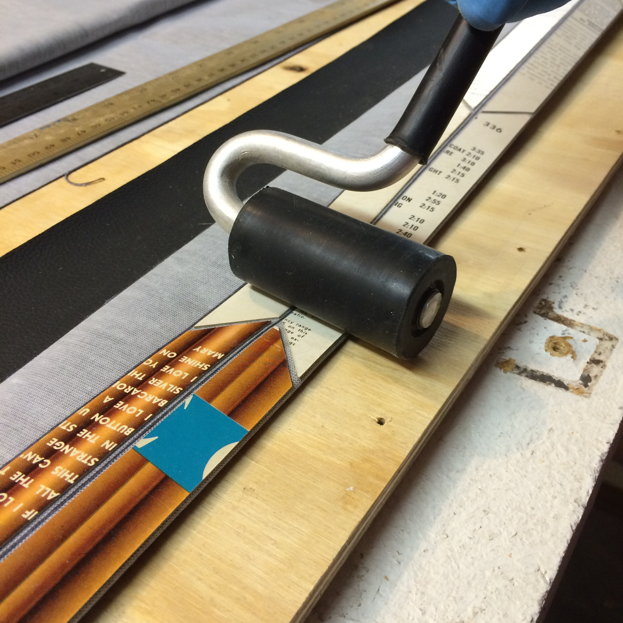 Gluing stiffeners down to vinyl for bellows