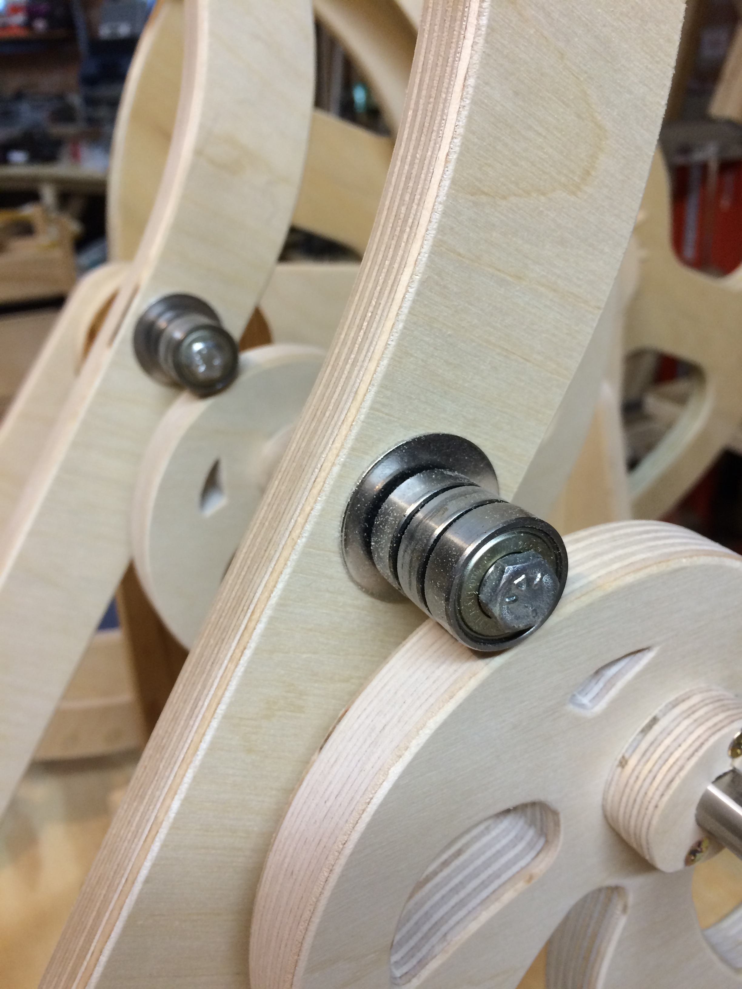 roller bearings on lever arms