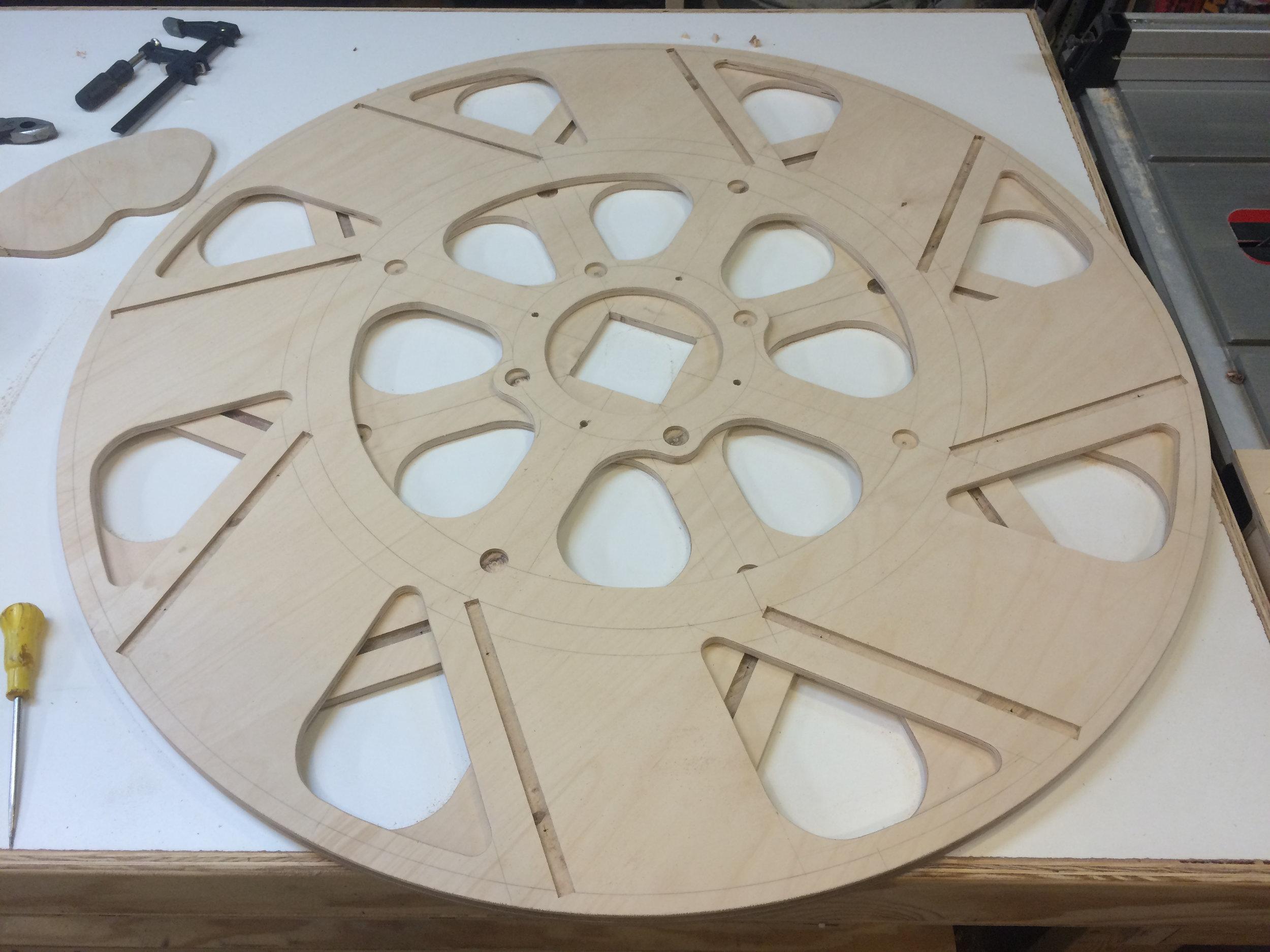 cutting spillways for the water which lighten the wheel