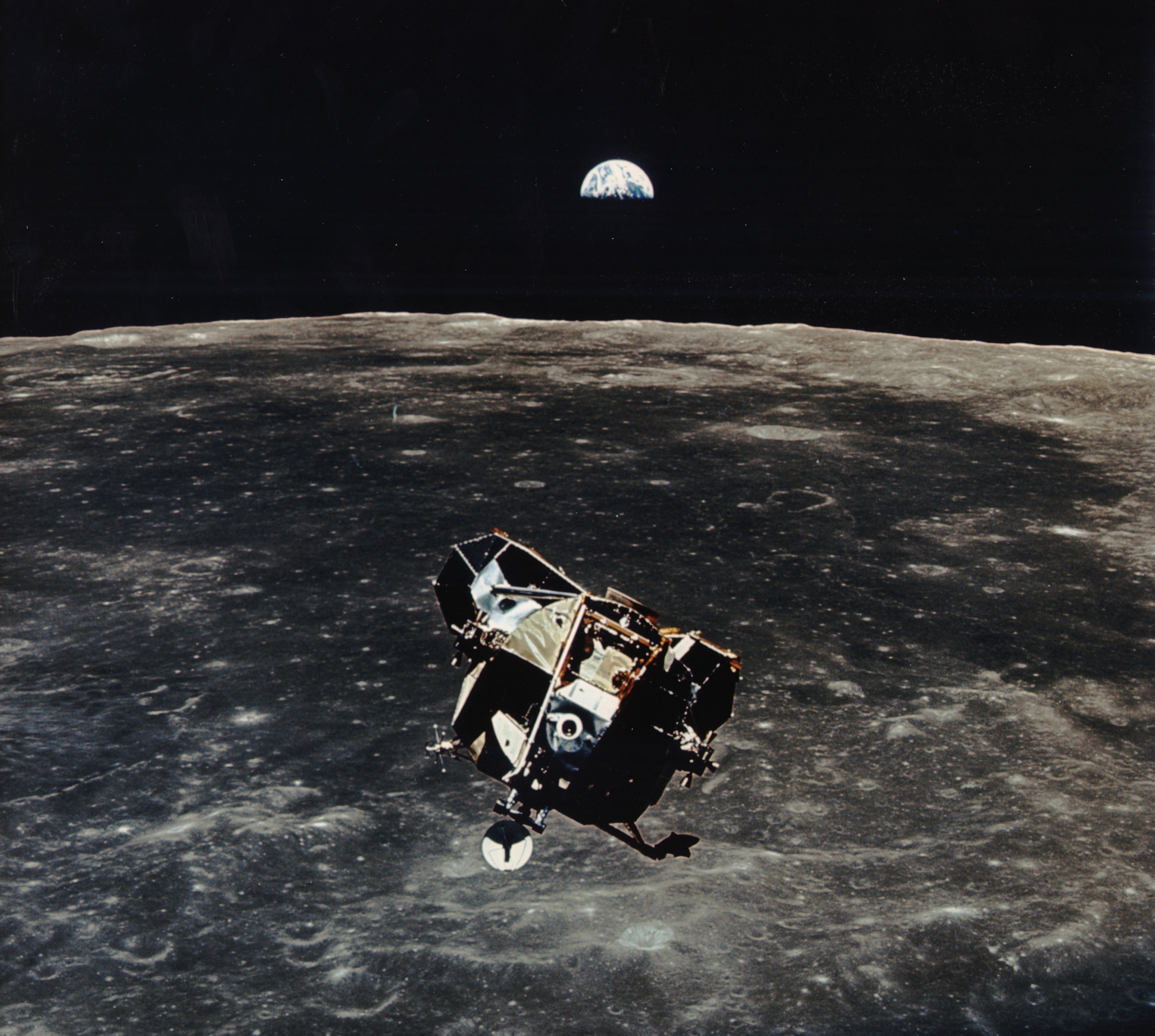 Apollo 11's Eagle with the Moon below and Earthrise (Courtesy of  NASA )