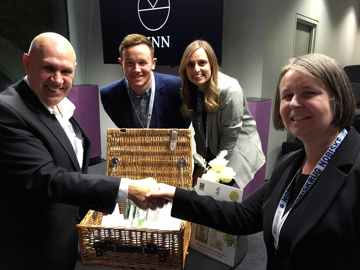 Julie Gauthier presenting  Gordon Castle  hamper to winner Kevin Drayton, One17  with team Matthew Lee and Kerry Doyle