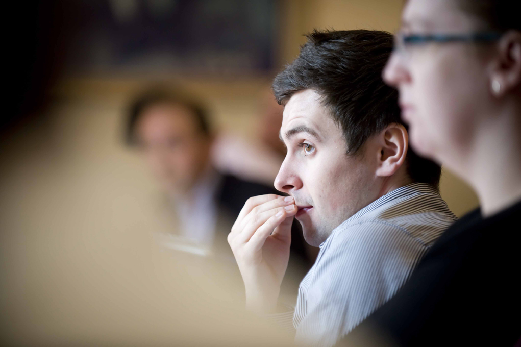 Candid portrait of an attendee looking thoughtful at an event